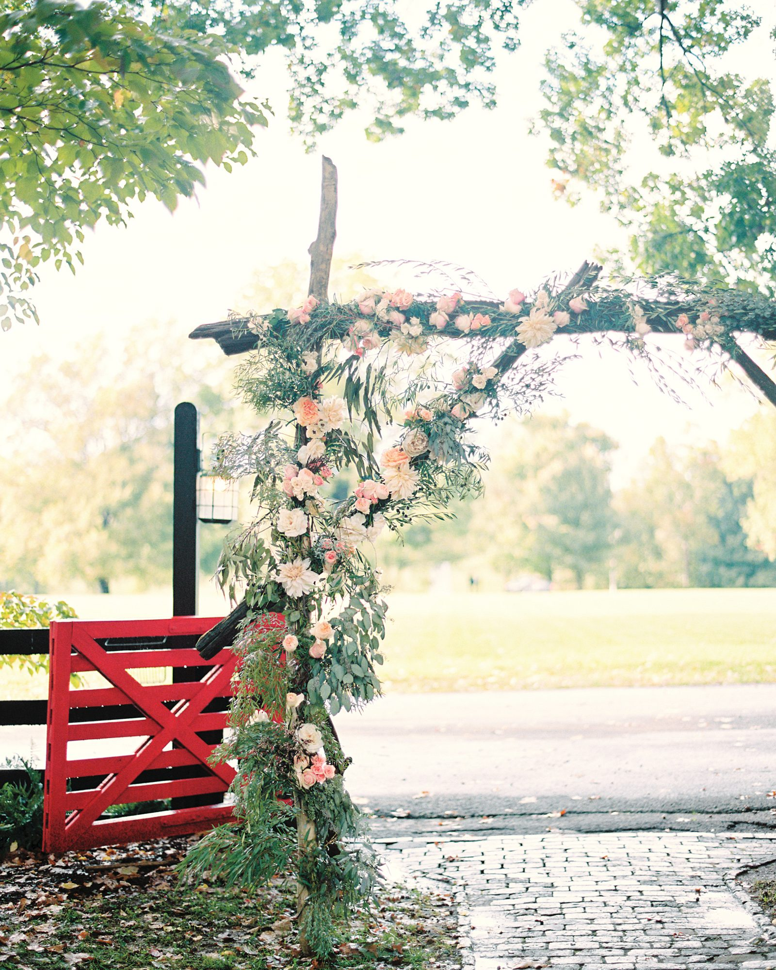 Unkempt Willow Branch Wedding Arch with Pink and Orange Flowers