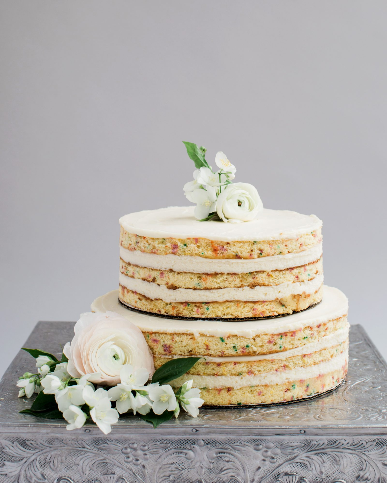 "Show off those sprinkles! This one-tiered naked wedding cake (by Belmond El Encanto) put the ""fun"" in ""Funfetti."""
