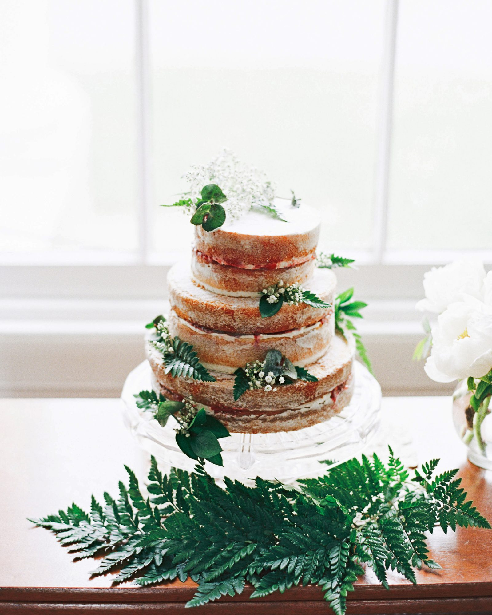 Our mouths are watering just looking as this decadent naked cake. Sticky Spatula baked the dessert, which was covered in foliage.