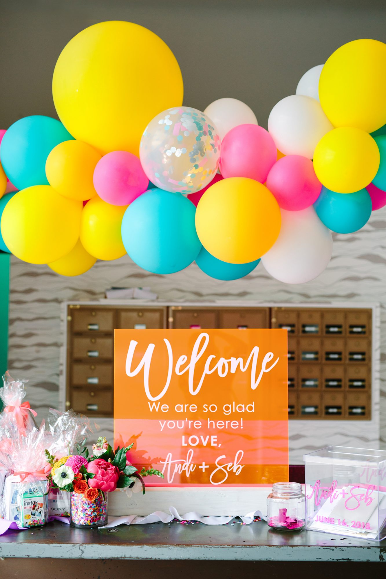 neon orange welcome sign and balloons
