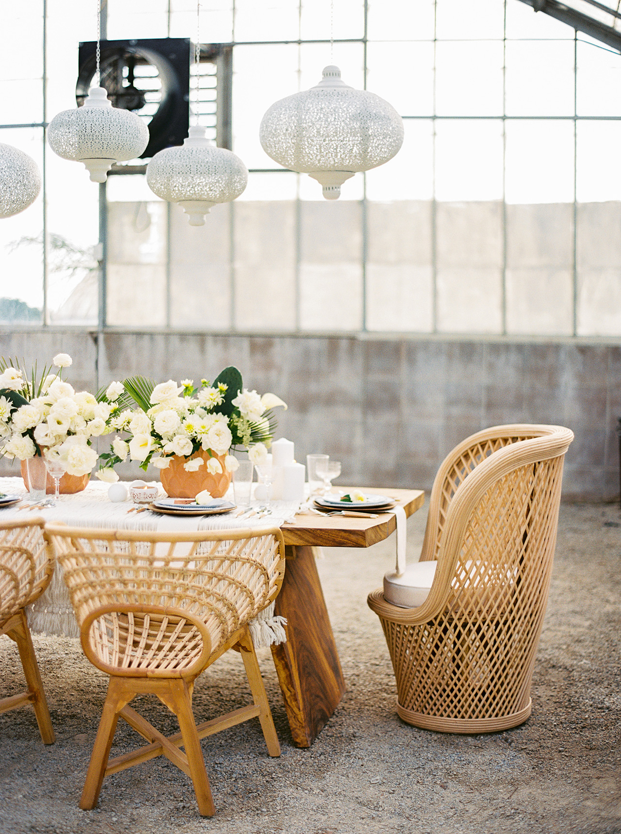 wicker chairs brunch party table setting