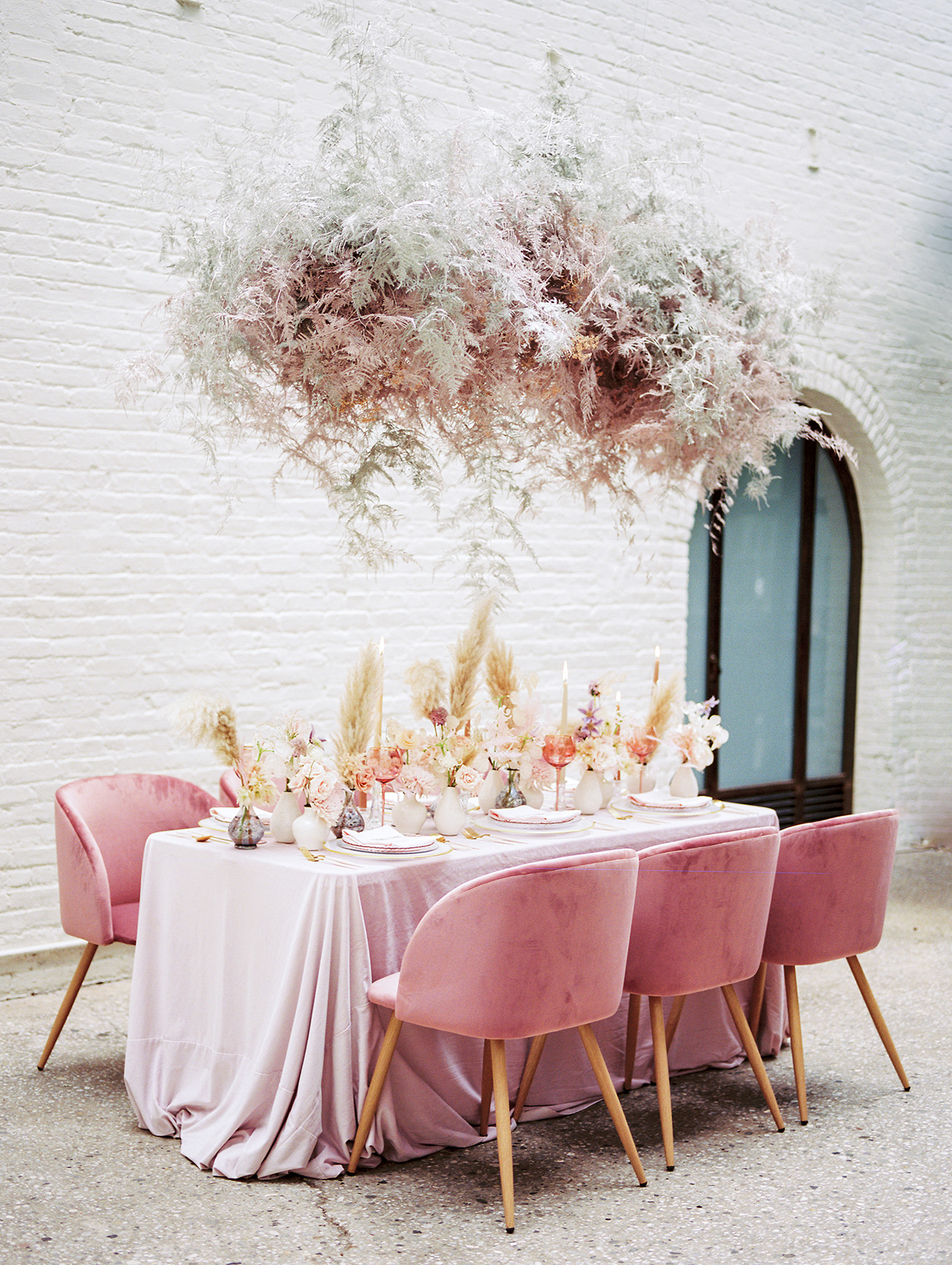 pink velvet and baby breath chandelier table space
