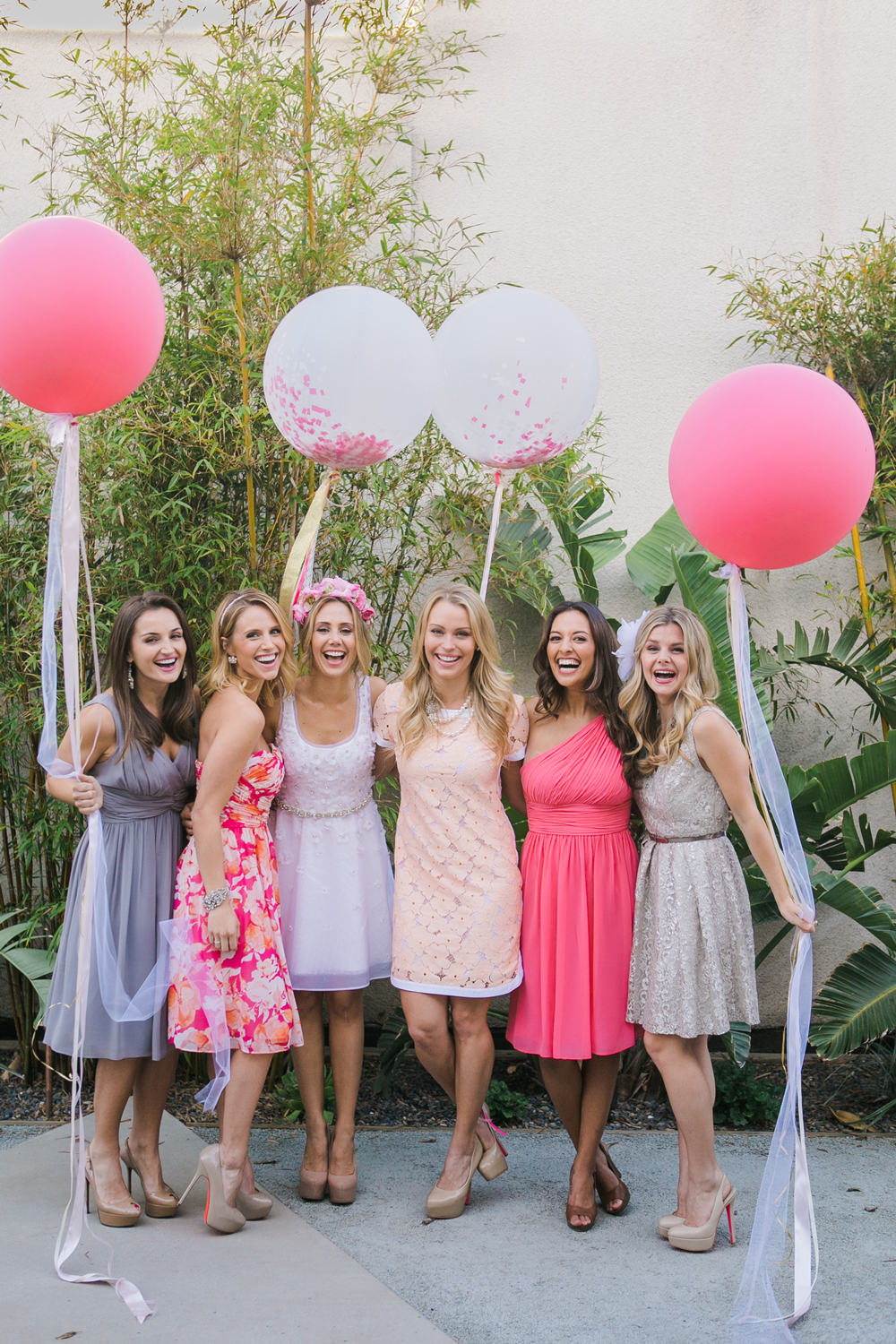be my bridesmaid girls holding pink balloons