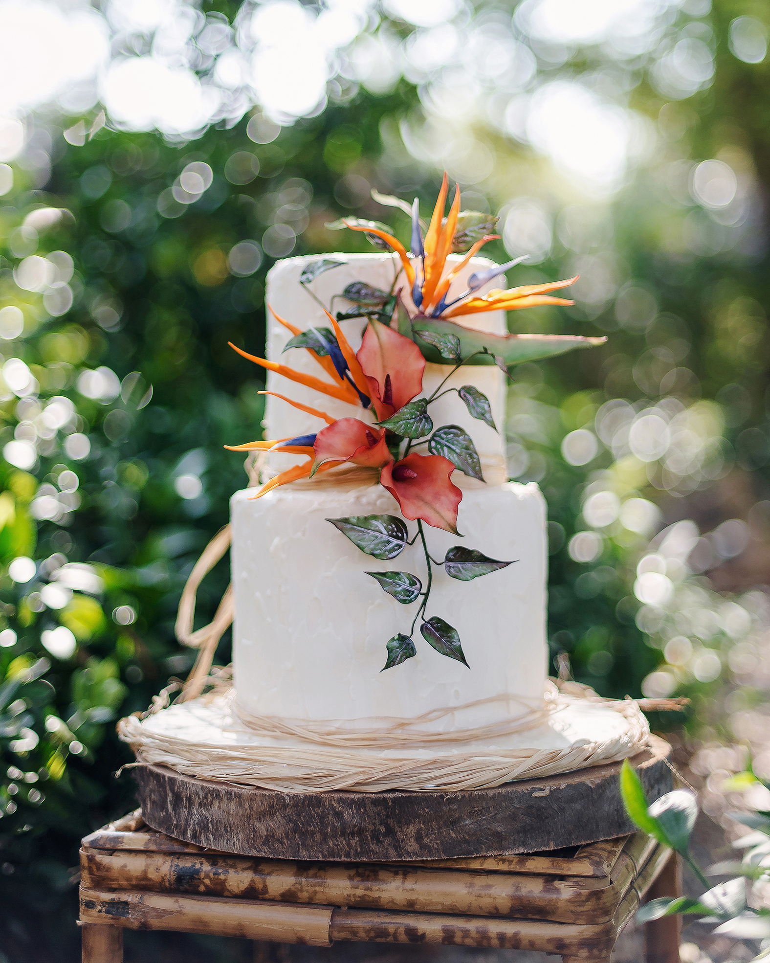 tropical wedding birds of paradise flower on white cake