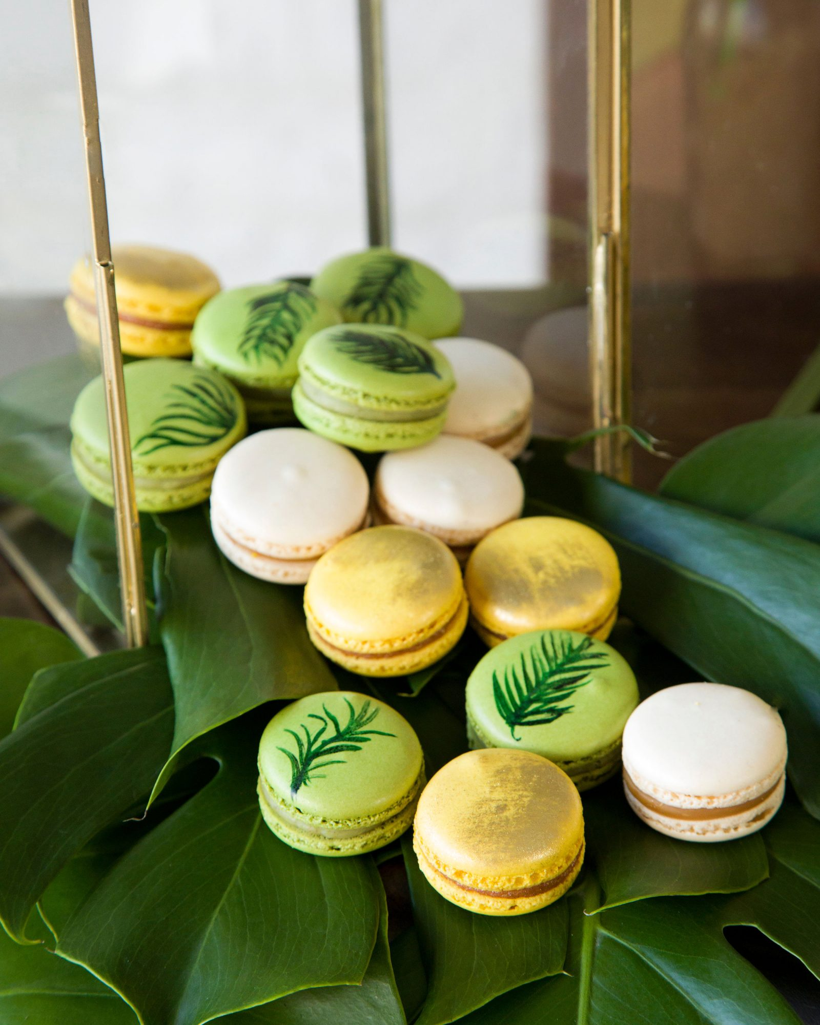 tropical wedding macarons with hand drawn greenery