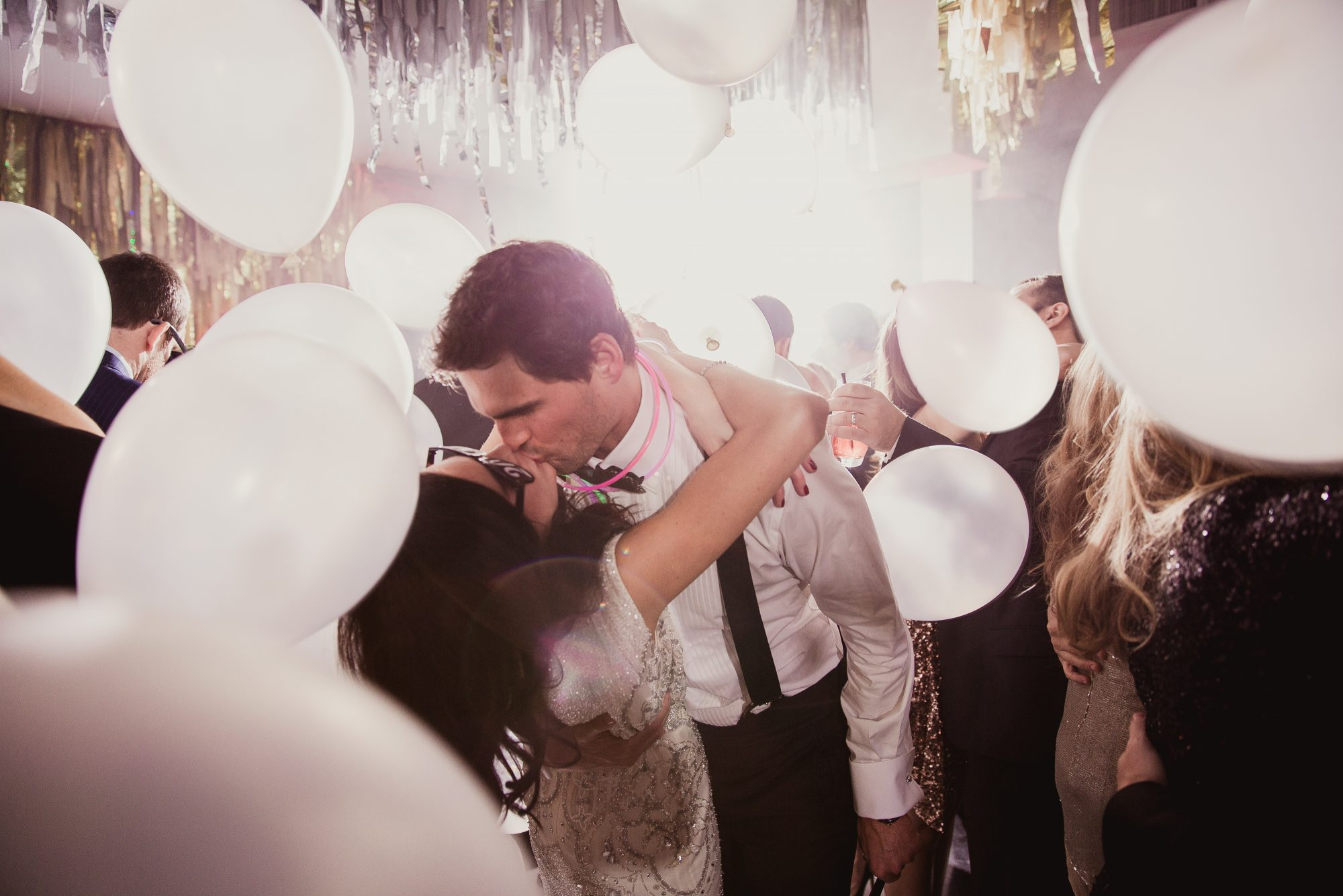 couple with balloons falling