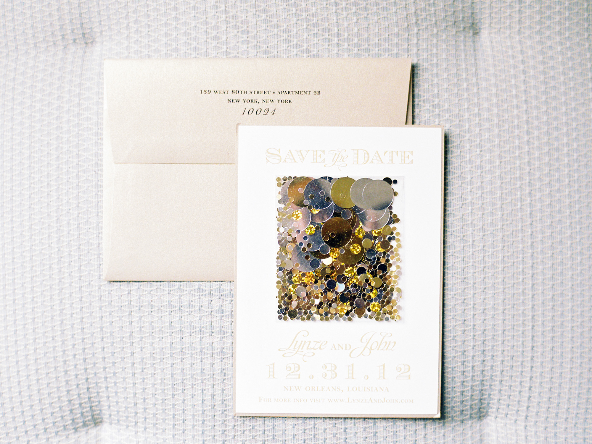 These save-the-dates were decorated with metallic confetti to give guests a preview of festivities.