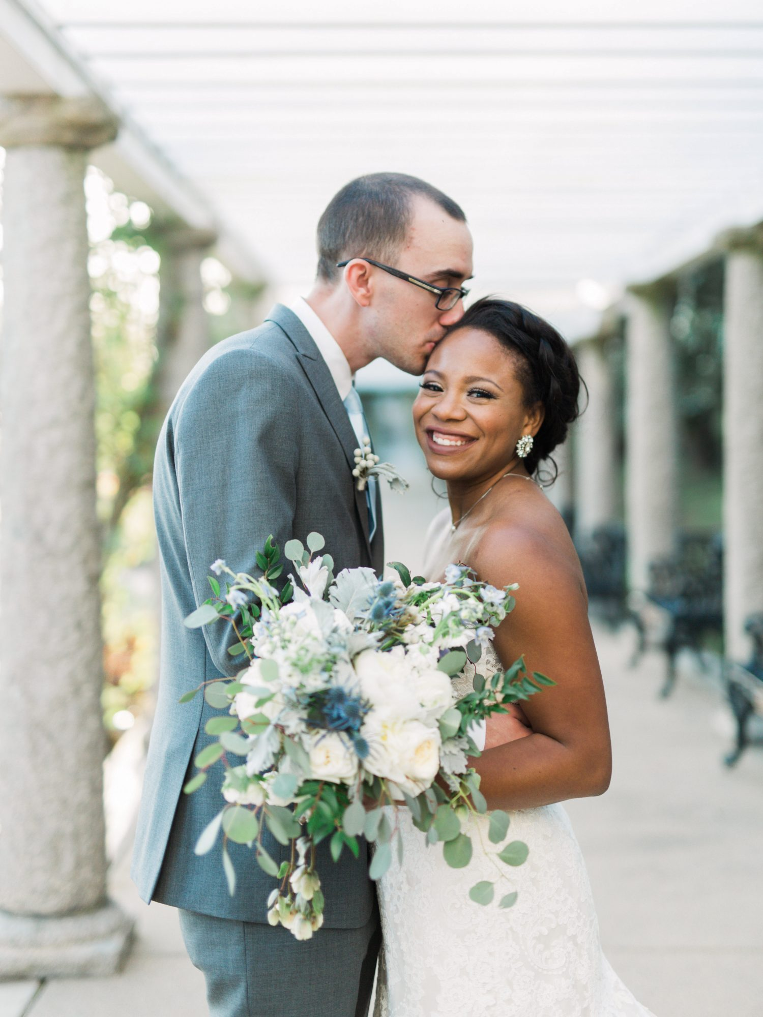wedding bride groom pose outside with bouquet