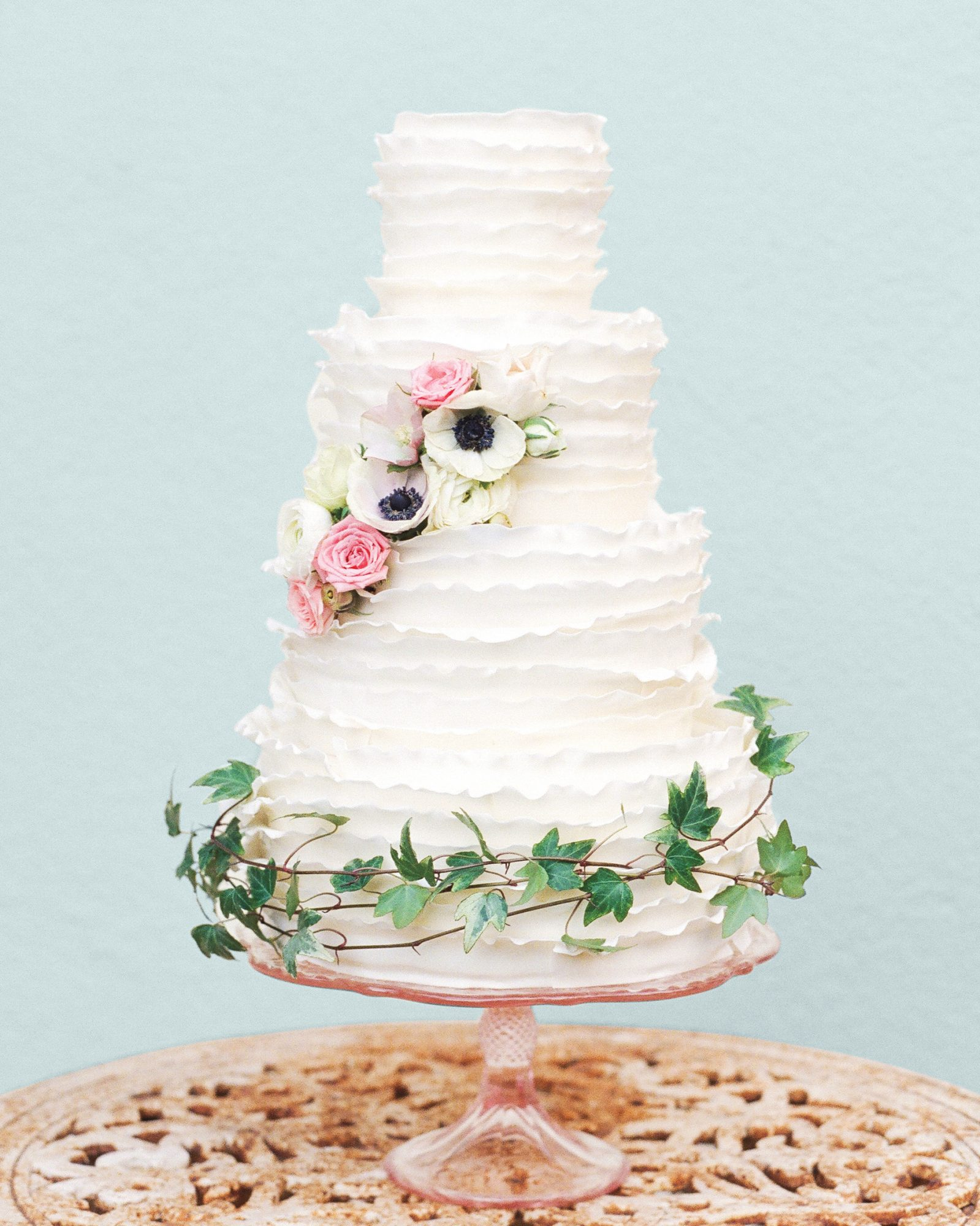Pink roses and white anemones adorned this deckle-edge wedding cake created by Cake Fanatics. While this dessert was made for a tropical Hawaiian wedding, it would be equally pretty for a classic celebration.