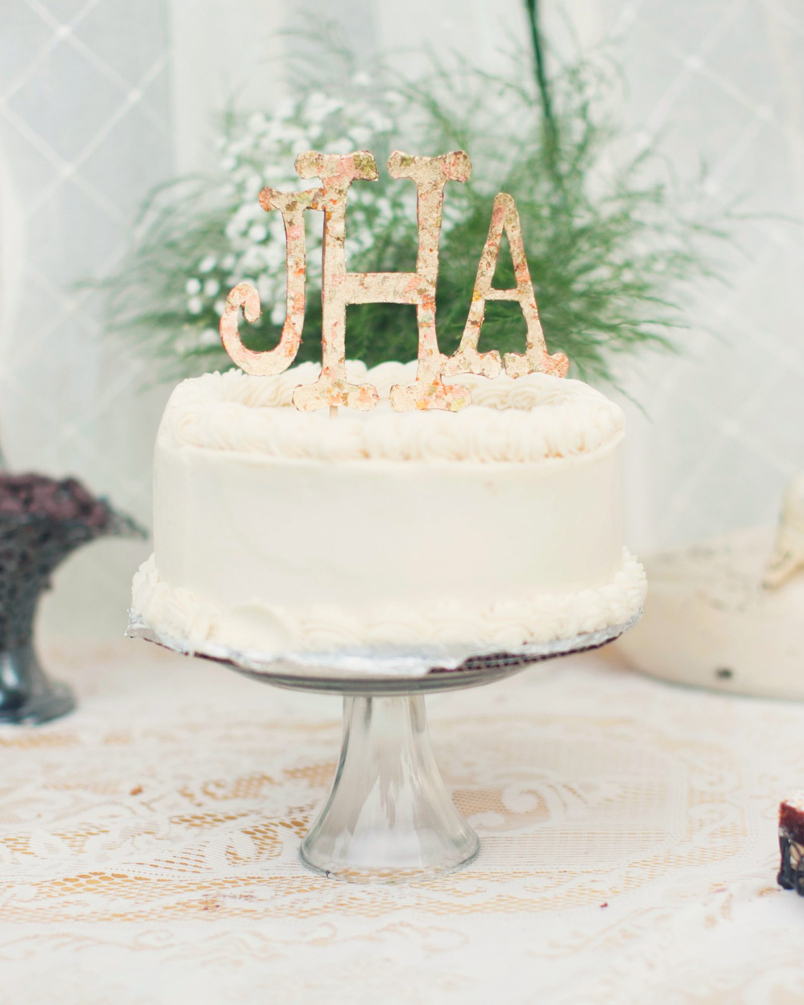 Order a moderately priced, plainly decorated cake, and make the focal point the cake topper. Vintage bride-and-groom figurines, wedding bells, horseshoes, a basket filled with fruit, or a pair of doves (from an antiques shop or handmade) are classic symbols that can make a cake memorable.