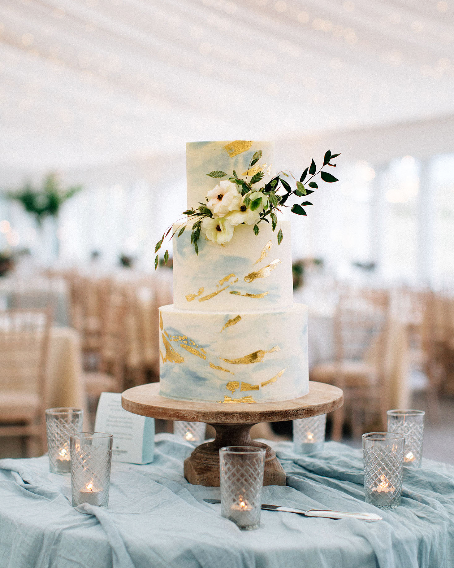 There's a good reason why this wedding cake, which was brought to life by Cloudberry Cakery, has as many pins as it does. The swirled buttercream confection was flecked with blue and gold leaf to evoke the sea.
