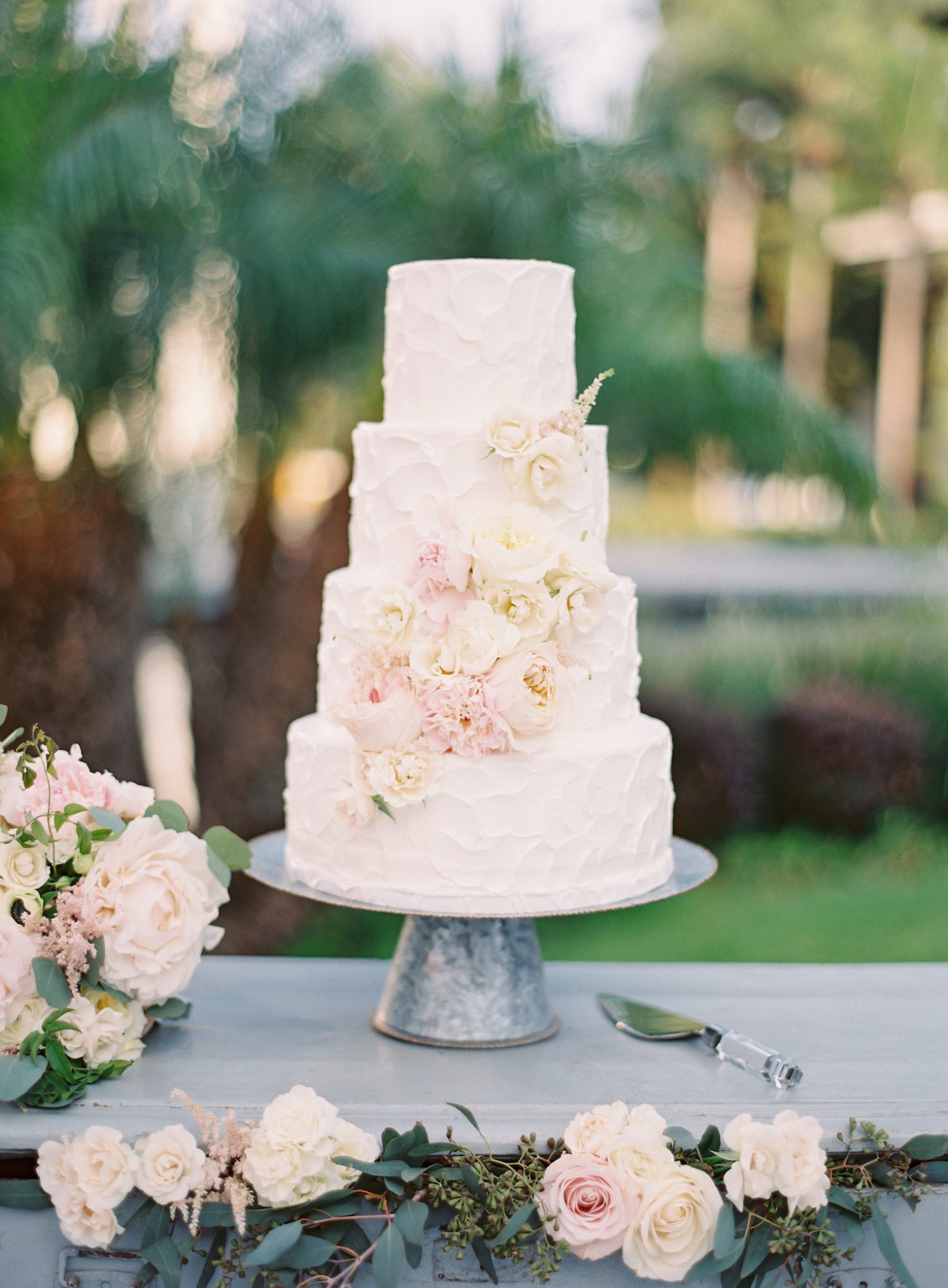 This sweet, textured confection was decorated in springy, bridal hues like blush and cream.