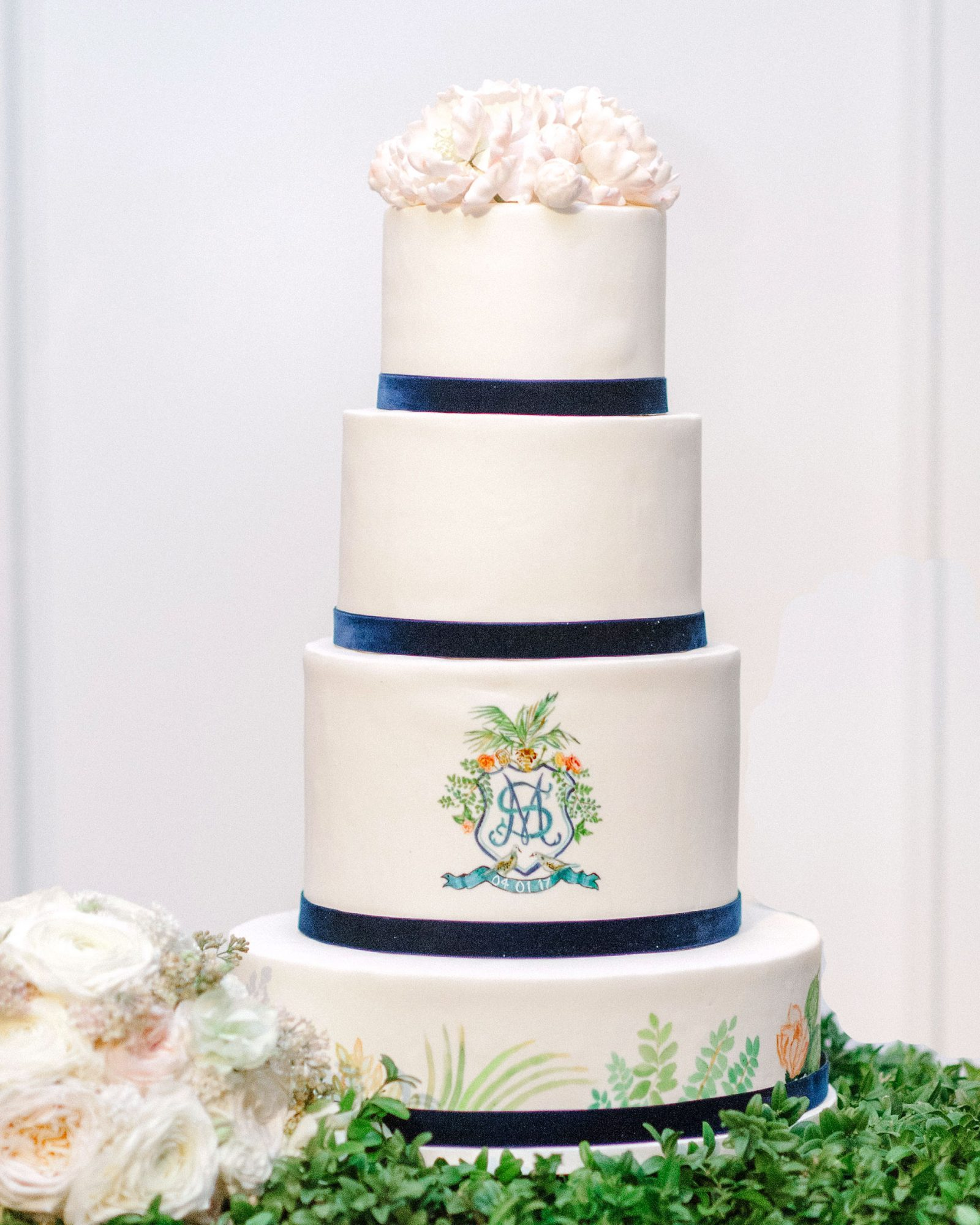 You can also use velvet on your wedding cake. Each tier of this Minette Rushing confection was trimmed in blue fabric.