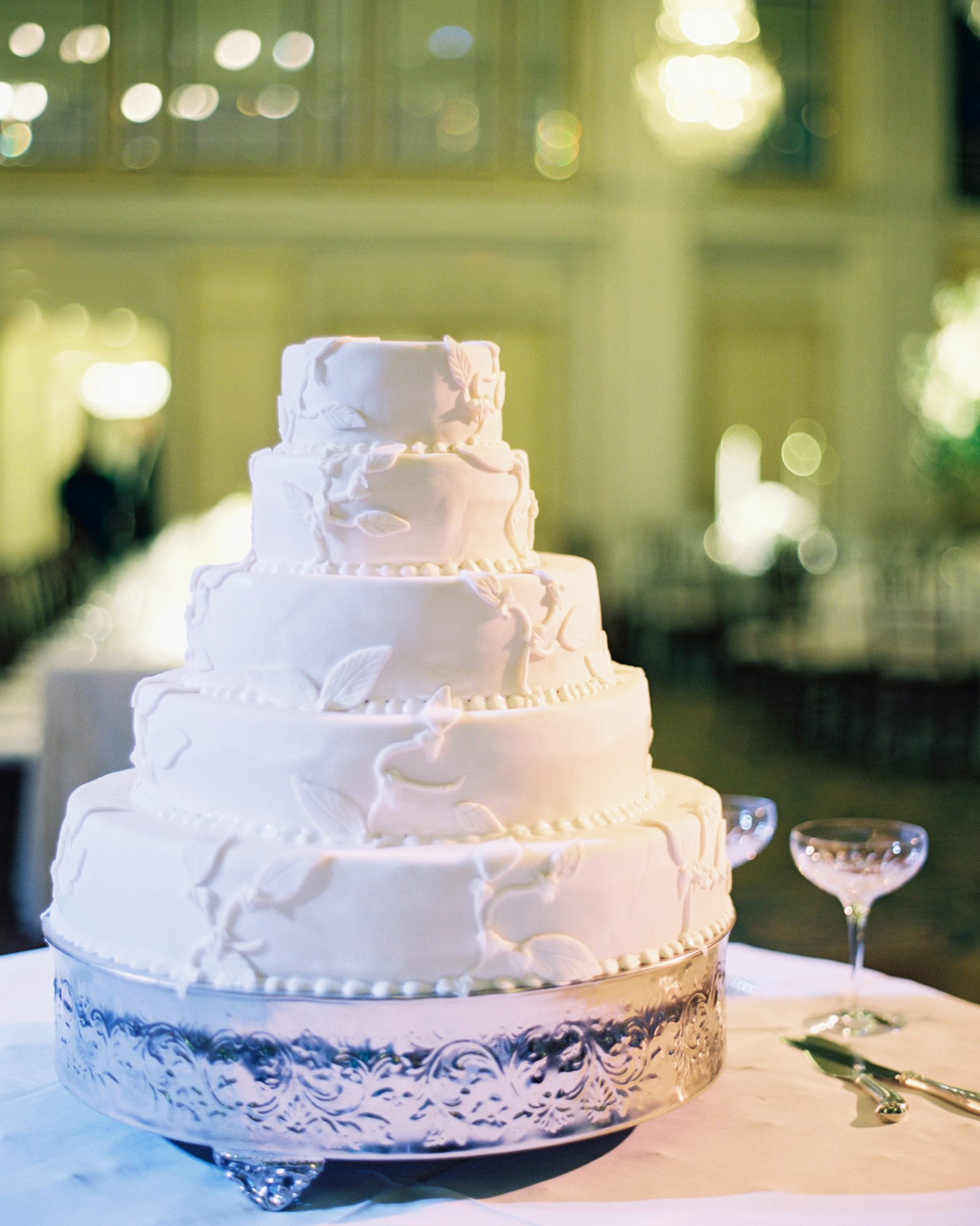 Why not choose a wedding cake that features your favorite flavor and your hubby's too? This five-tiered, white wedding cake by Willard InterContinental Washington combined the groom's go-to flavor, banana, and the bride's favorite, almond. They kept it simple on the outside, with a pretty floral design fitting for spring.