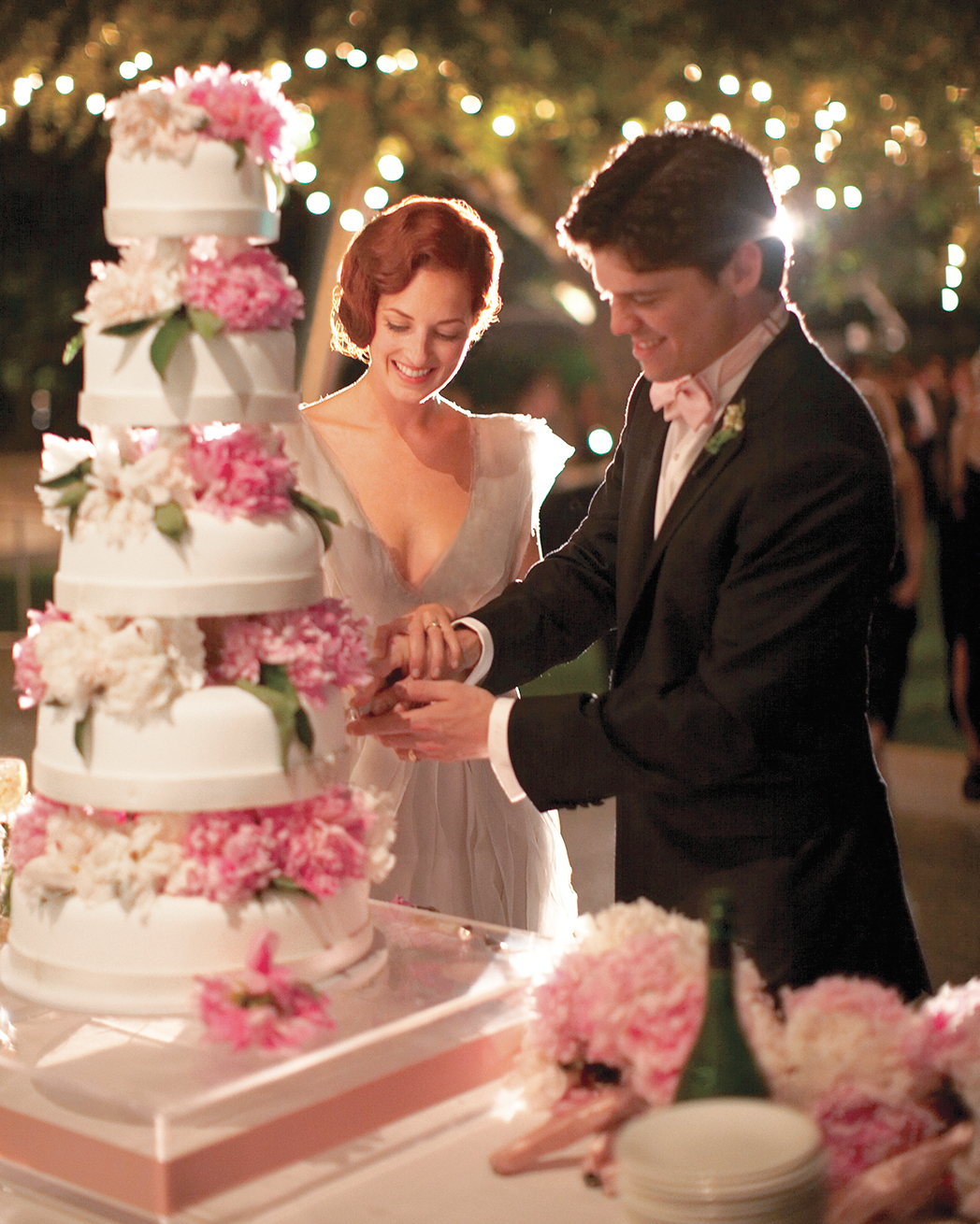 Taylor and Chase cut the cake -- a five-tier, fondant-covered tower of vanilla cake with a fresh-strawberry filling, which was topped with dozens of lush pink and white peonies in full bloom.