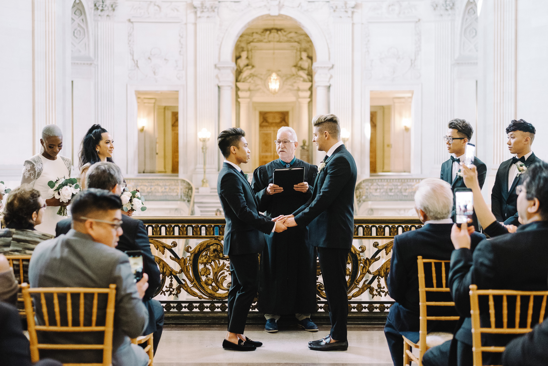 grooms during wedding ceremony at city hall