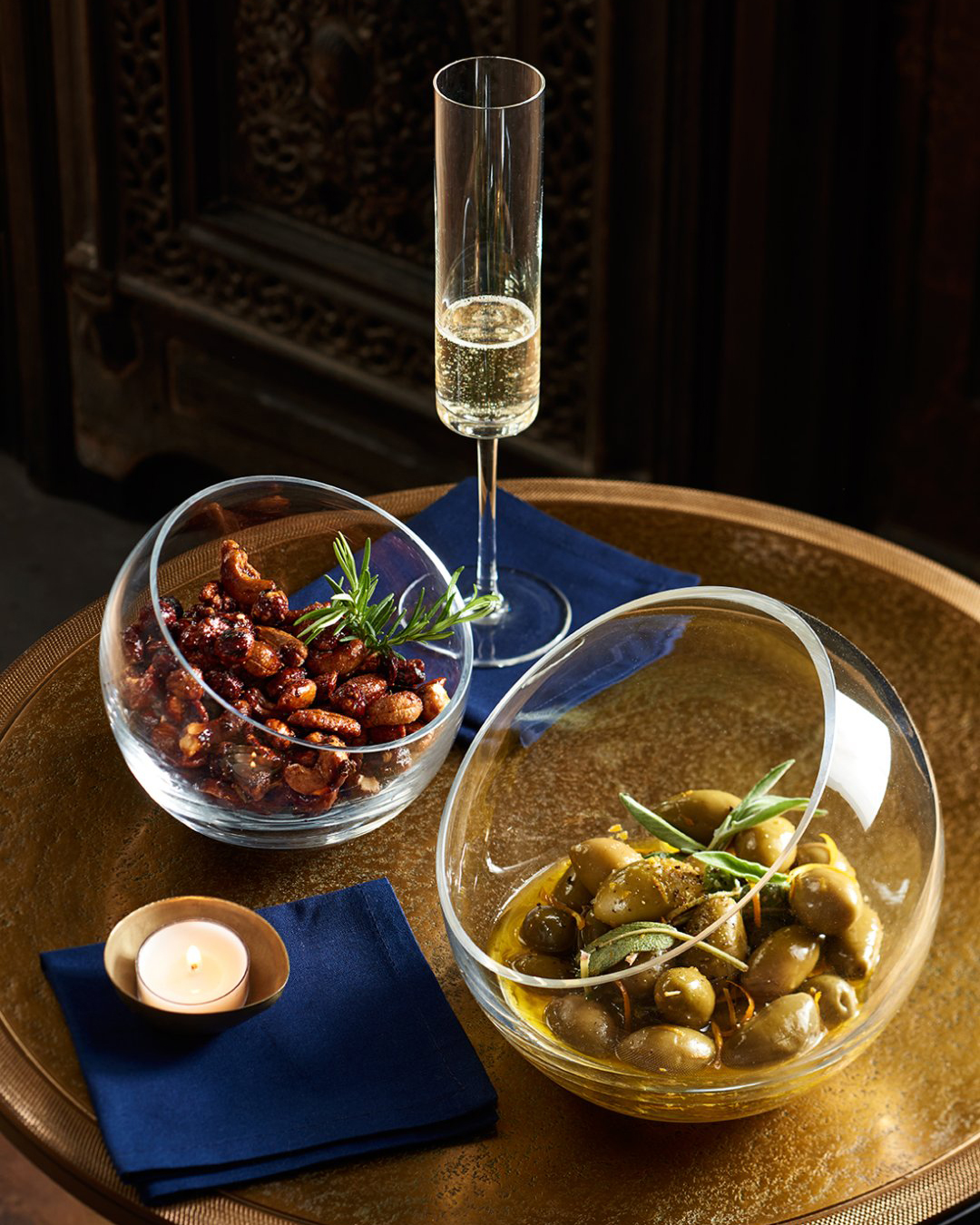 Champagne flute and olives