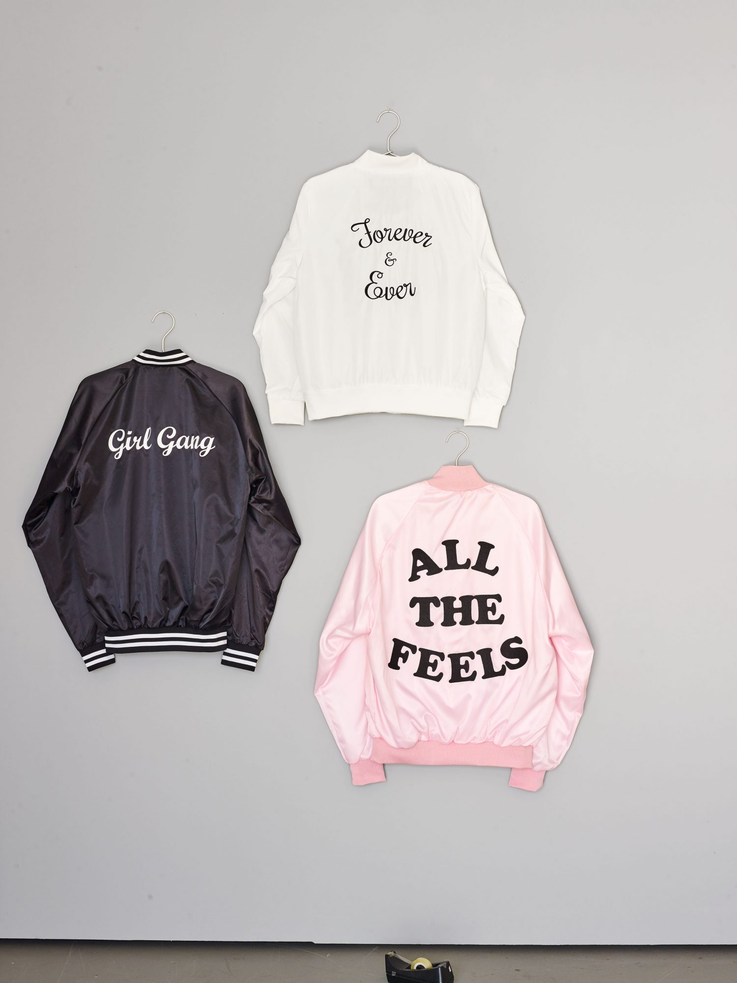 These chic jackets look both vintage and modern, and will ensure that outerwear doesn't ruin your crew's going-out outfits. Buy ones with words on them already, or customize them yourself using embroidery,heat-transfer printing, or affixable letters.
