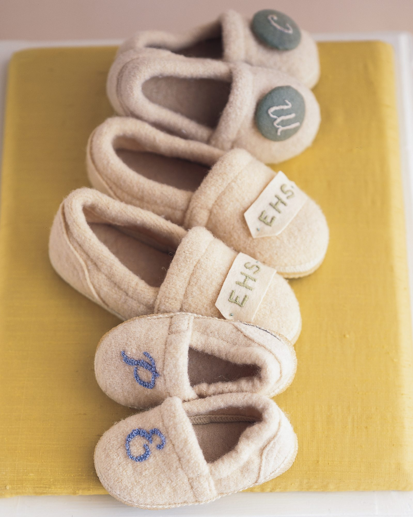 Present a personalized pair of snuggly slippers to your bridal party. Flower girls and 'maids alike will look forward to donning the monogrammed accessories during big-day prep.