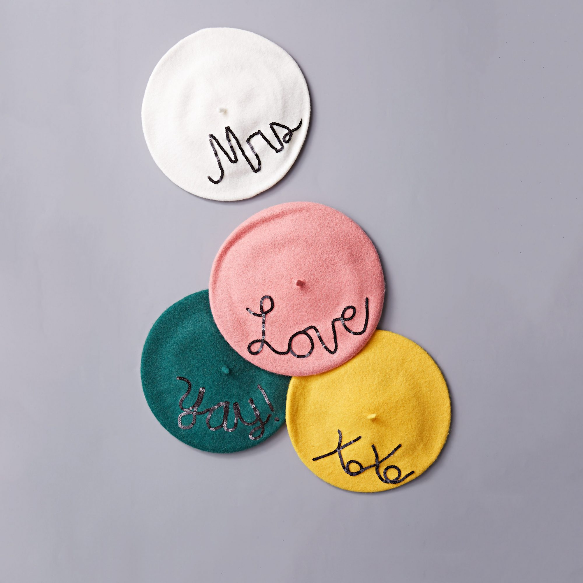 Gift your girls these chic accessories to wear during your bachelorette weekend. Simply purchase berets, freehand phrases using black sequin trim (a script font is easiest), then attach them using fabric glue. Mix and match different words and colors or make each hat uniform—either way, be sure to take an Instagram!