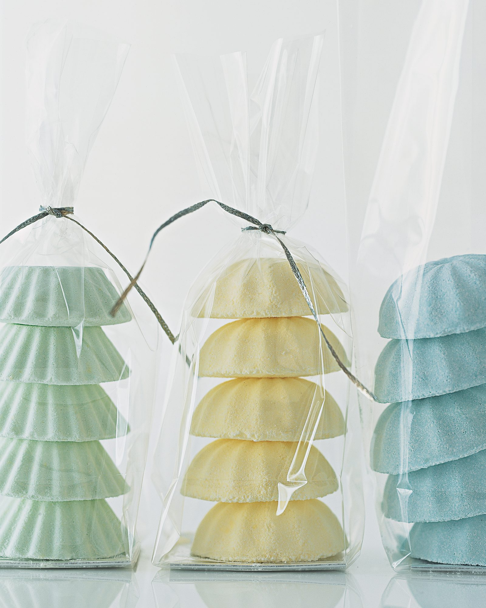 Basic baking molds form these fun bath bombs, which can be crafted using scents and colors that complement your wedding scheme.