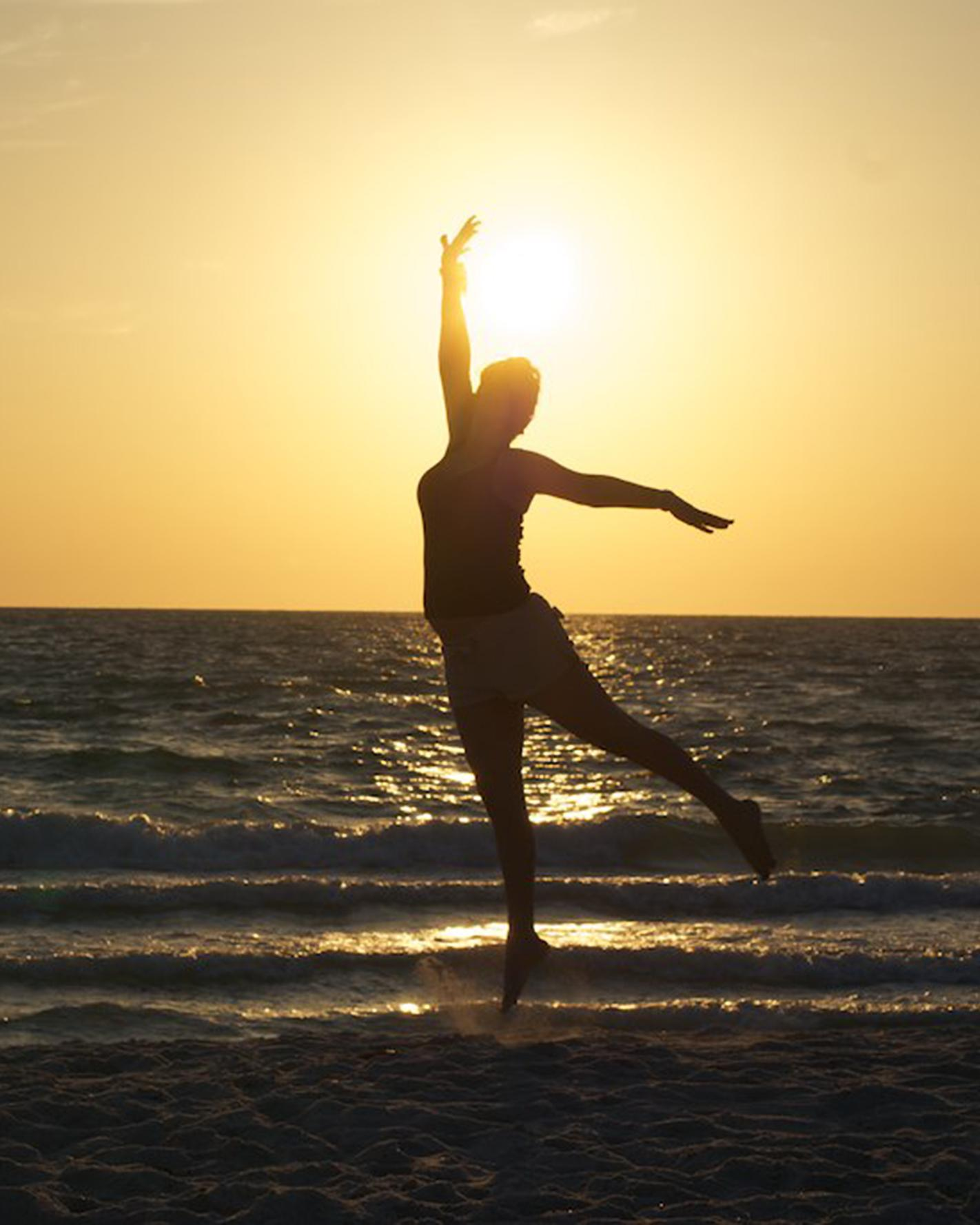 woman-jumping-beach-sunset-0615