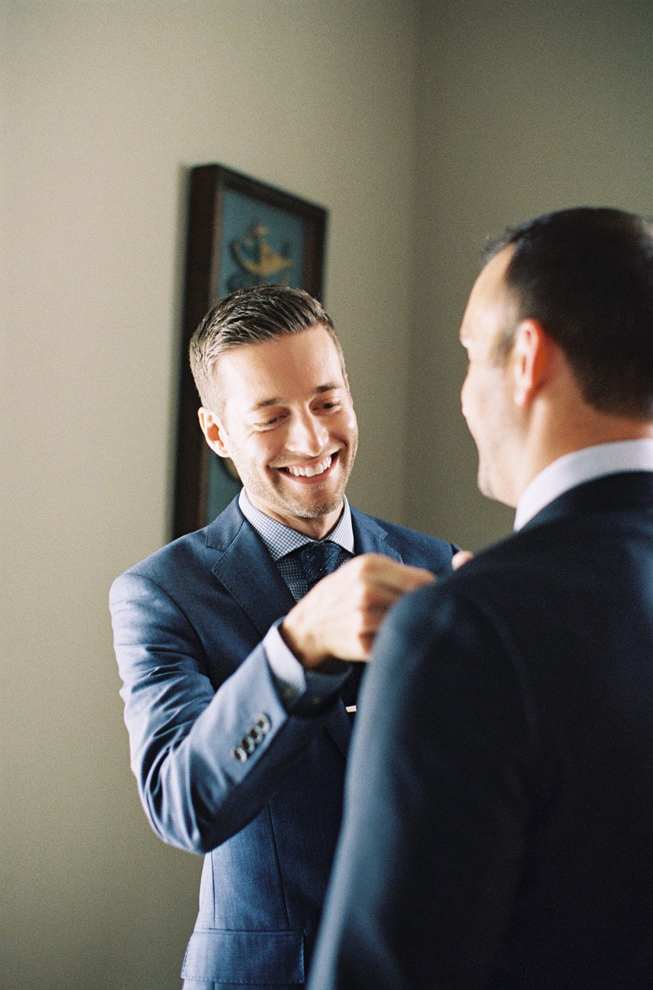 This groom couldn't help but smile with excitement as he and his future spouse got dressed for their wedding.