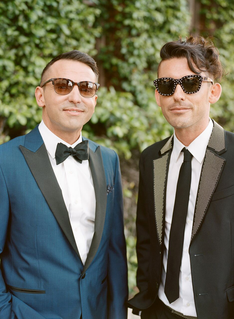 This fashion-forward couple had different wedding looks in mind, but agreed to style them with chic sunglasses for their portraits. We love how the groom on the right matched his studded sunnies to his embellished lapel.