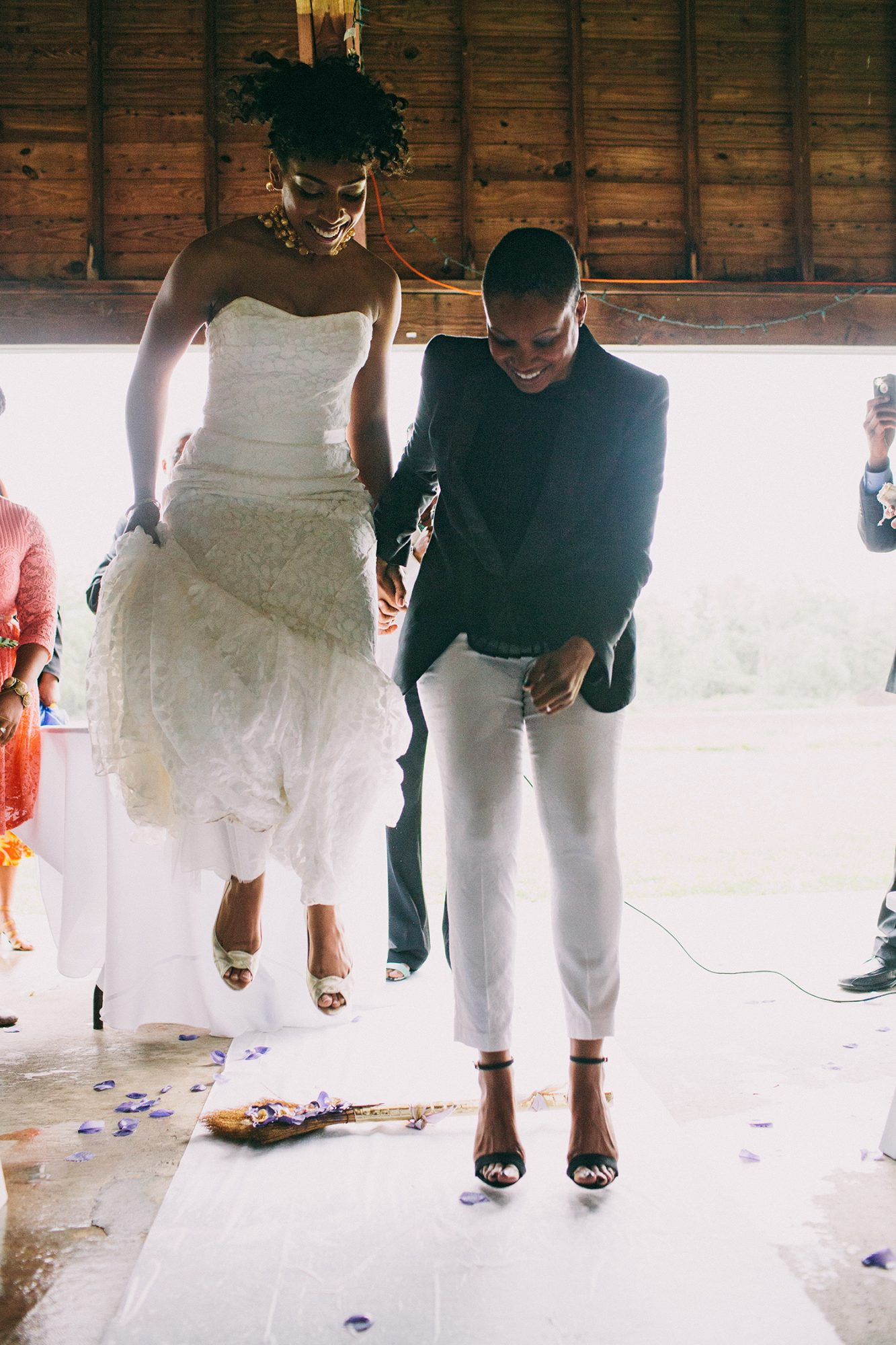 Another example of incorporating customs? Jumping the broom, like these joyful brides did.