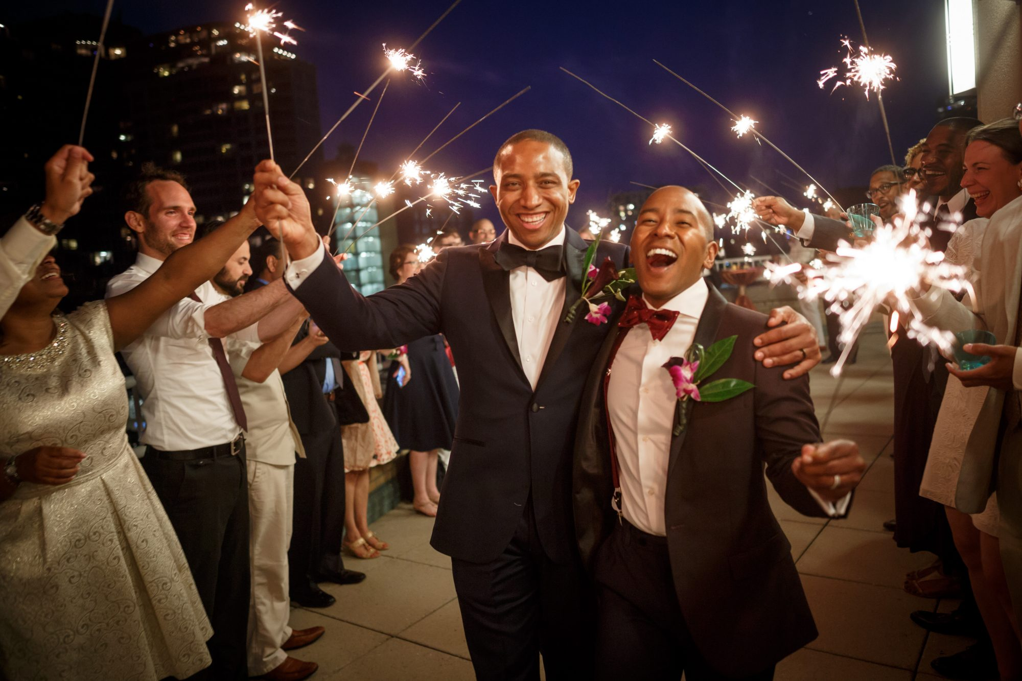 These delighted grooms lit up the night as they exited their wedding, with both their smiles and their sparklers.