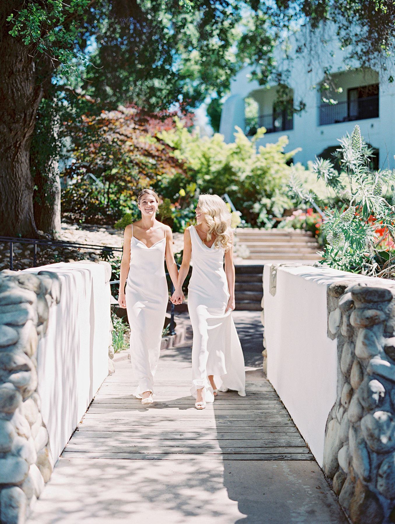Go ahead and schedule some alone time together. These brides held hands as they took an intimate stroll, for example.