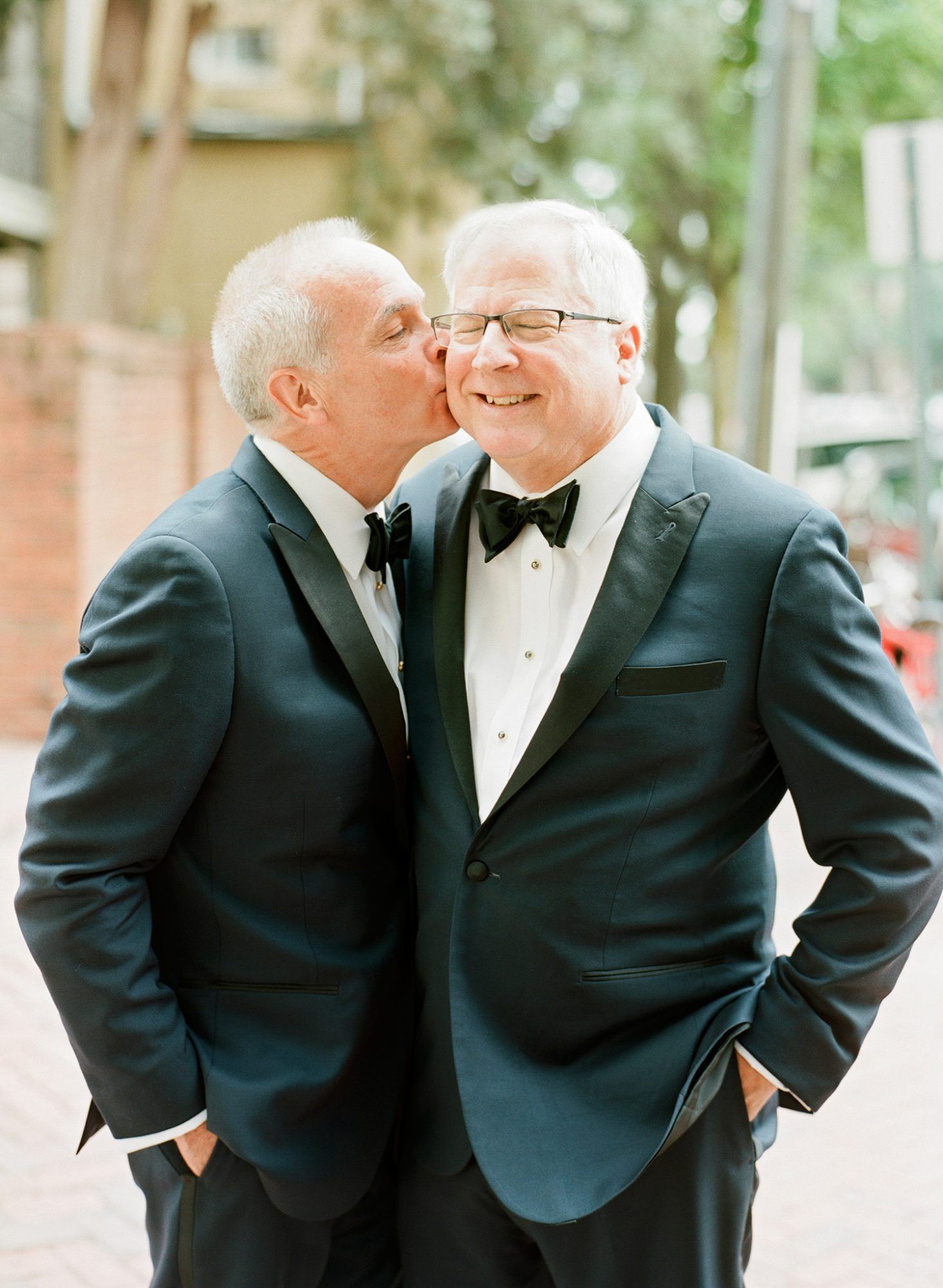 How endearing is this sweet snapshot of two grooms celebrating their special occasion?