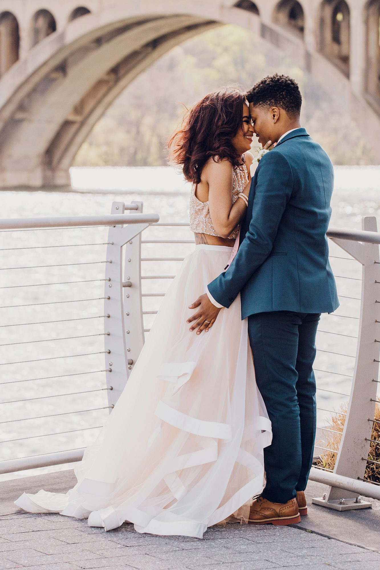 These brides touched noses as they soaked in the meaning of their big day.