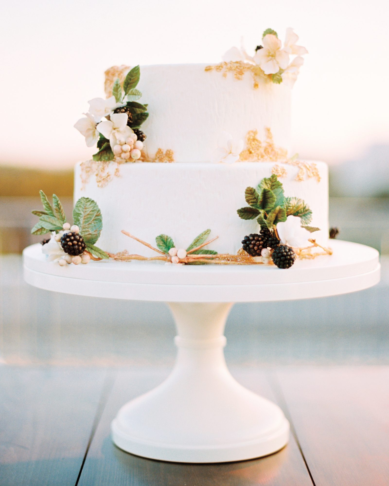 Ringed with sugar flowers, greens, and blackberries, this simple cake brings a little bit of nature to a Washington, D.C., wedding.