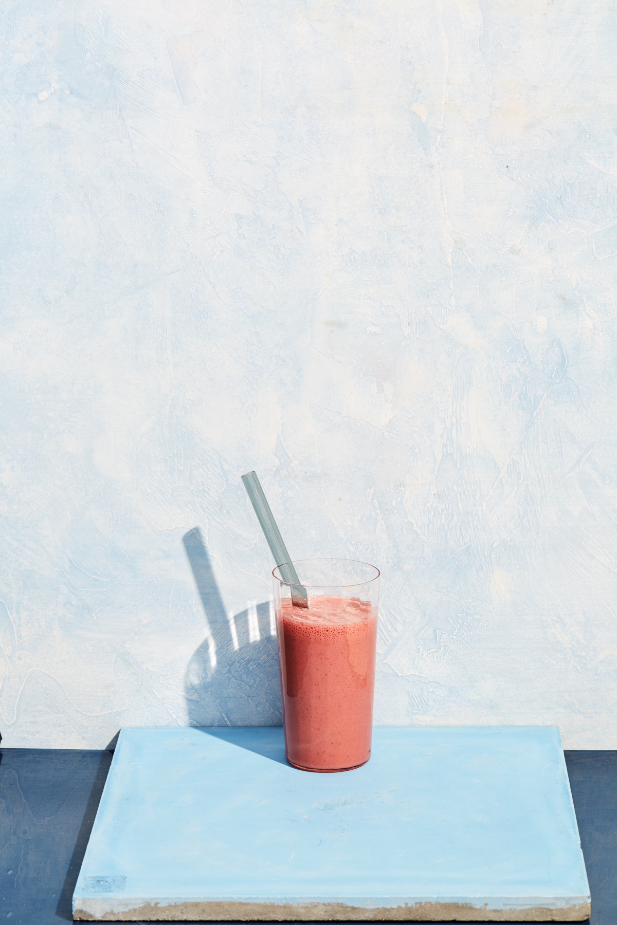 cherry smoothie with blue background
