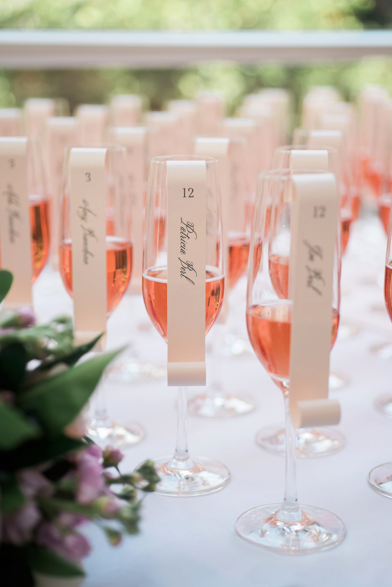 rose glasses with escort card scrolls