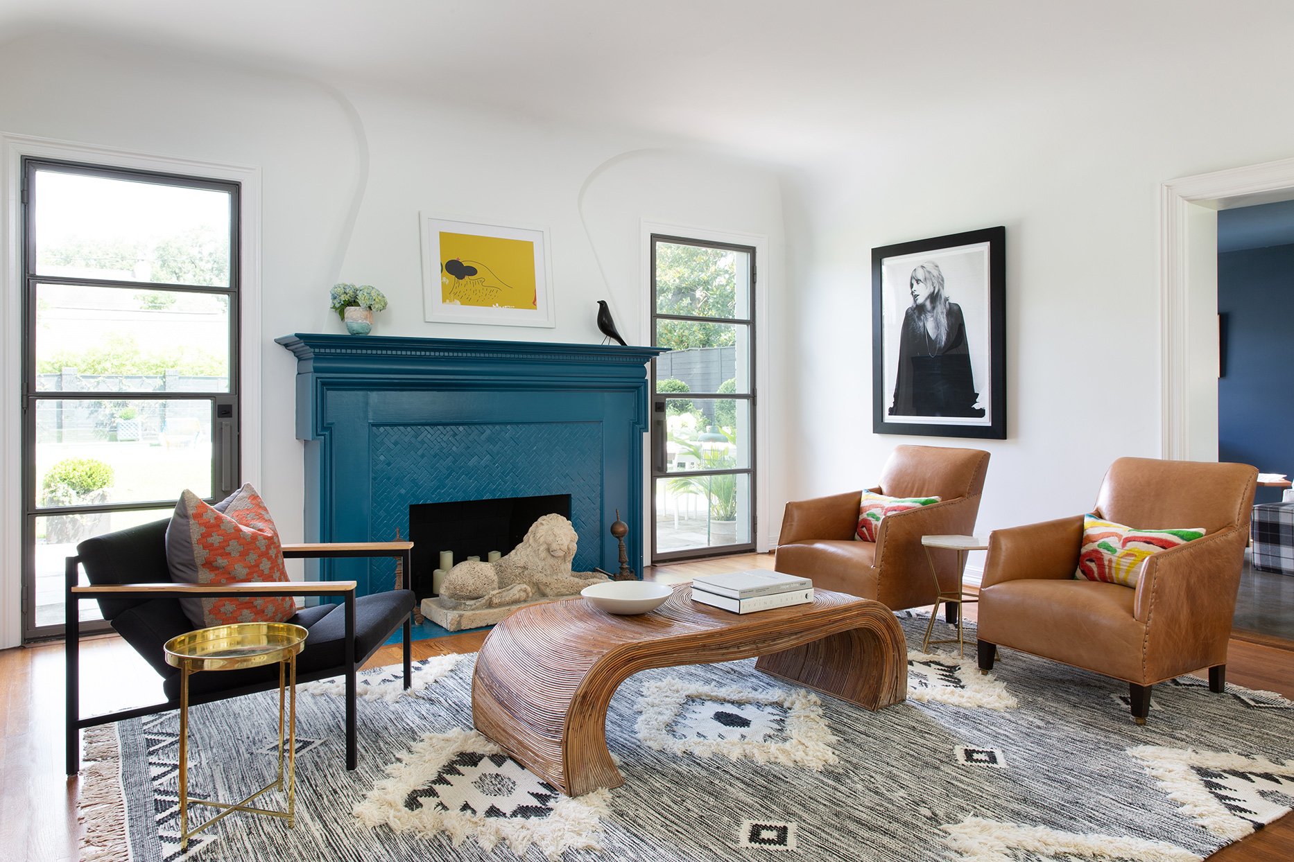 white living room with leather chairs and blue accents