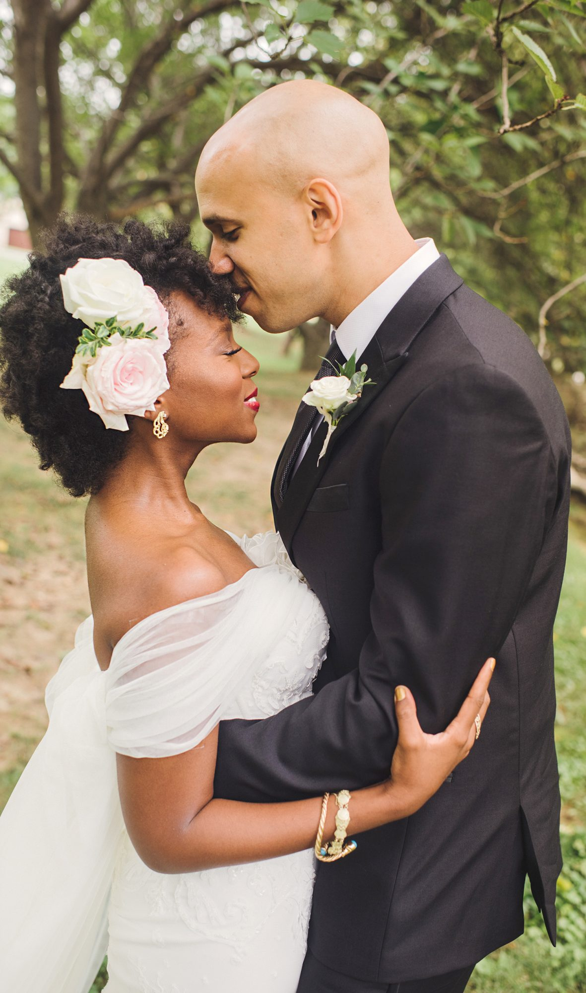 bride with natural curls and floral hair accessories
