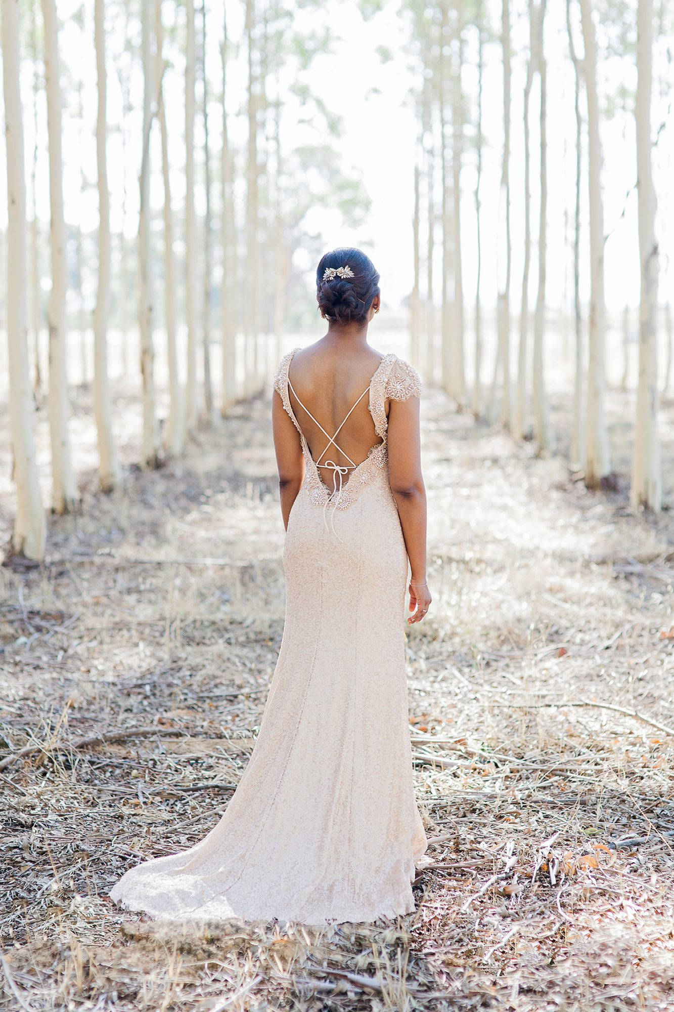 bride with open-back dress and chic bun