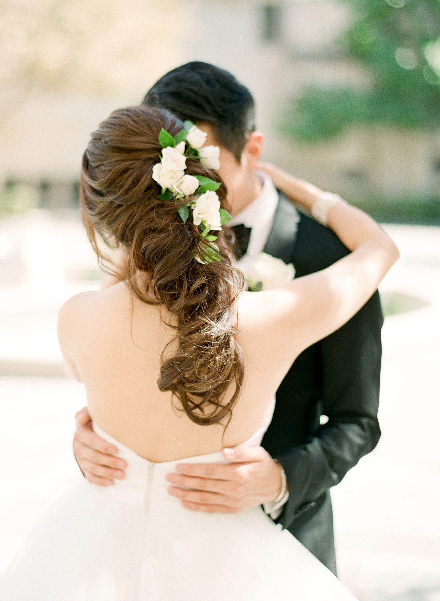 bride with loosely breided hair and flowers