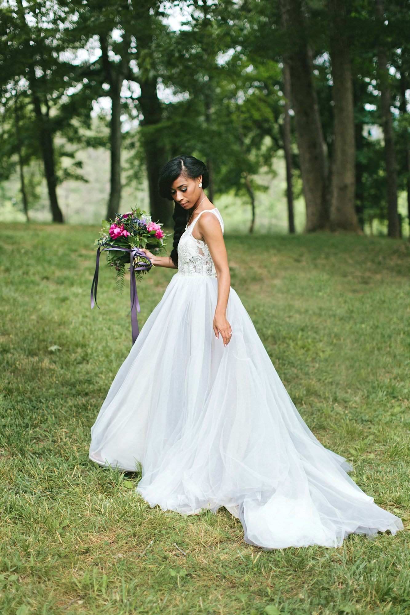 bride with v-neck dress and side braid