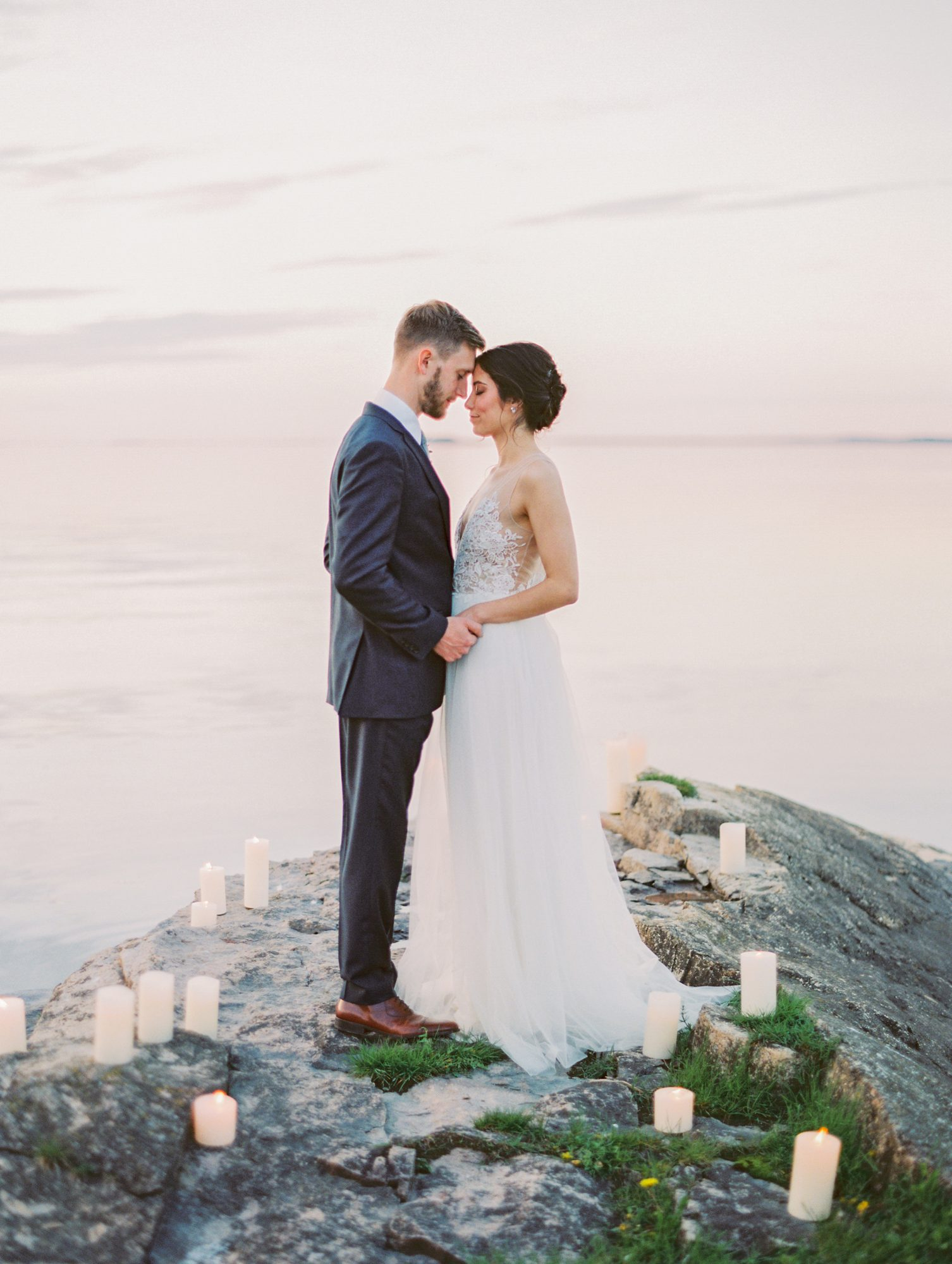 couple standing on jetty