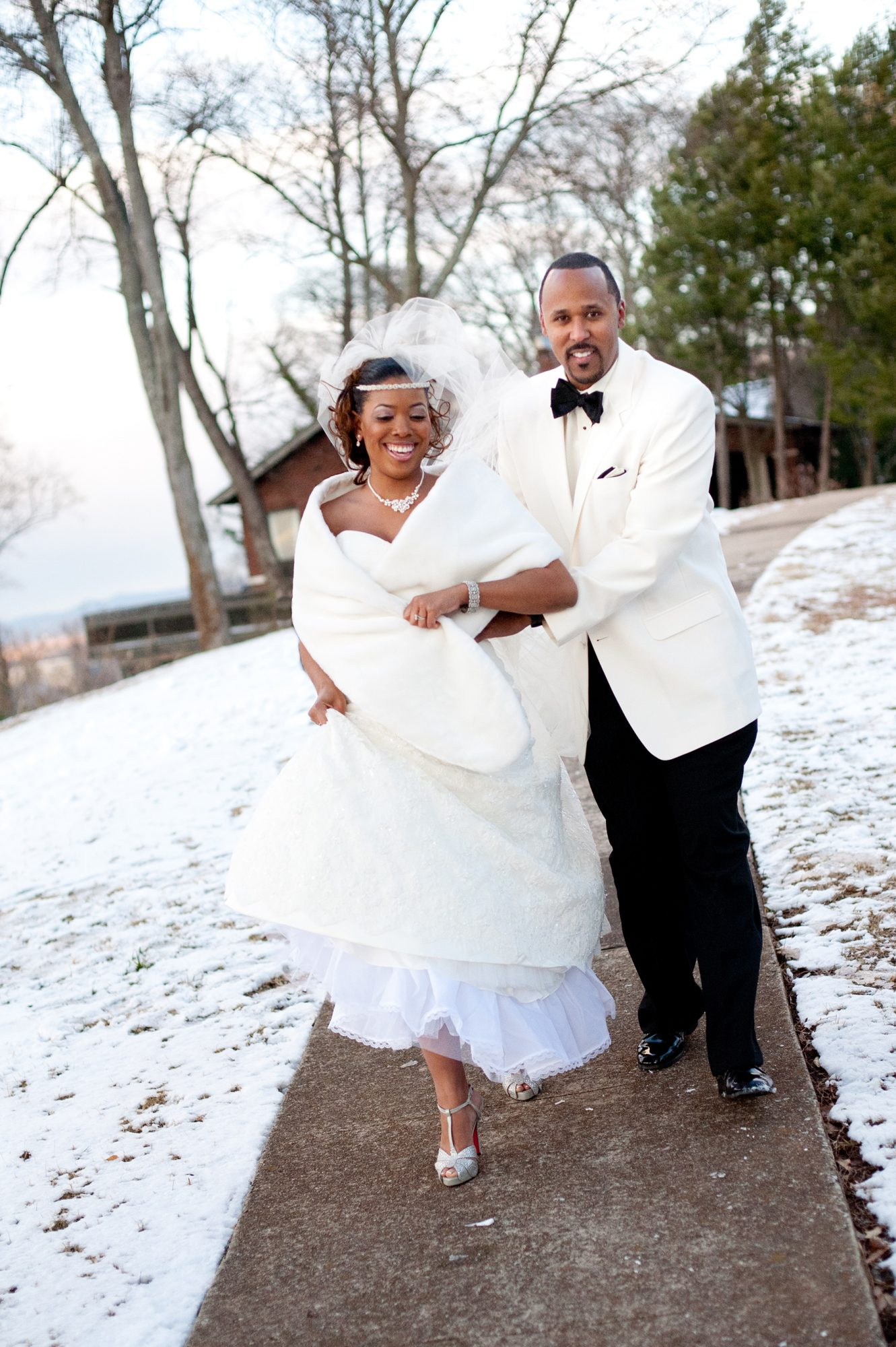 Bride and Groom Running in Snow