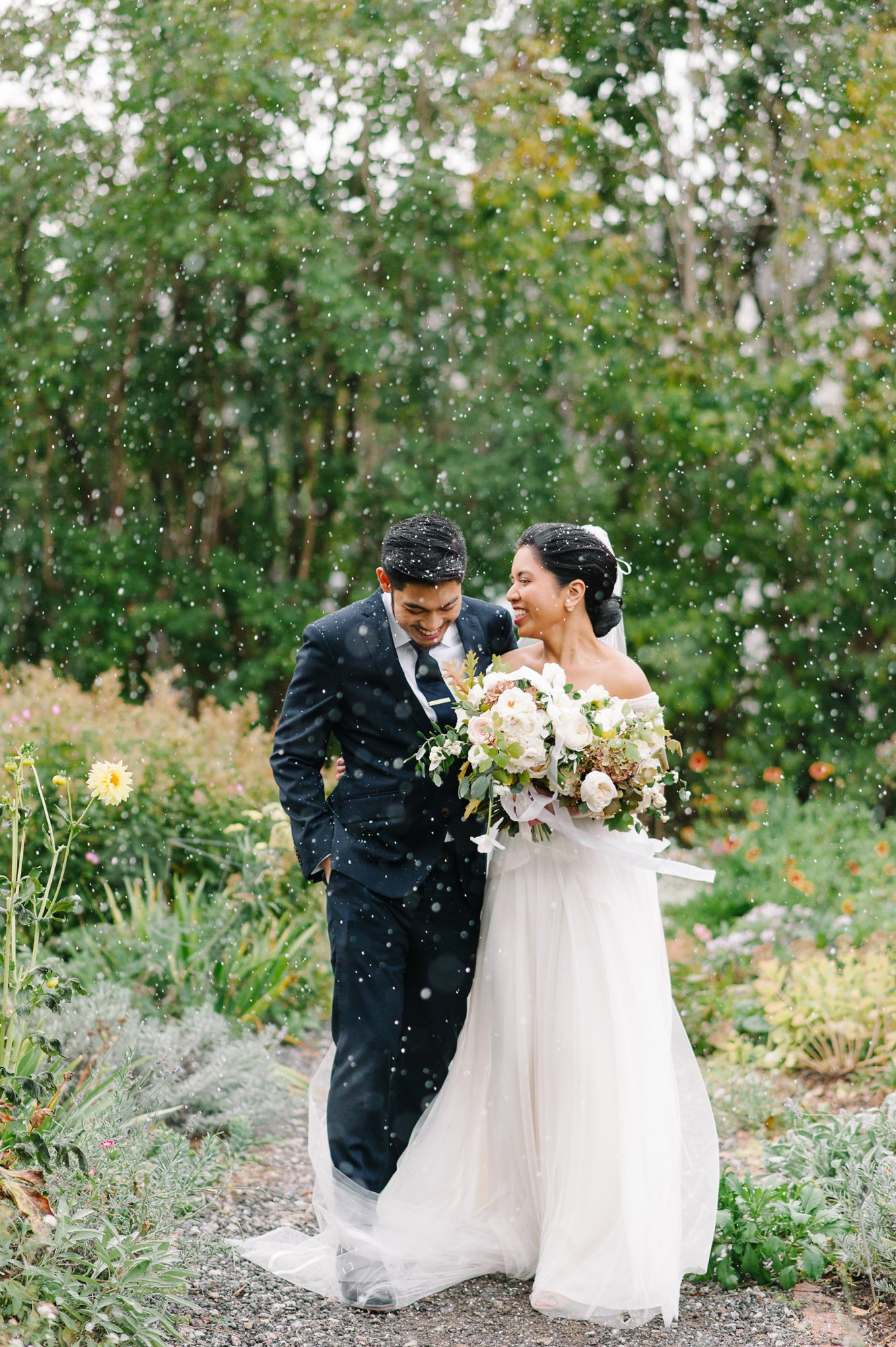 Couple Laughing During Snowfall