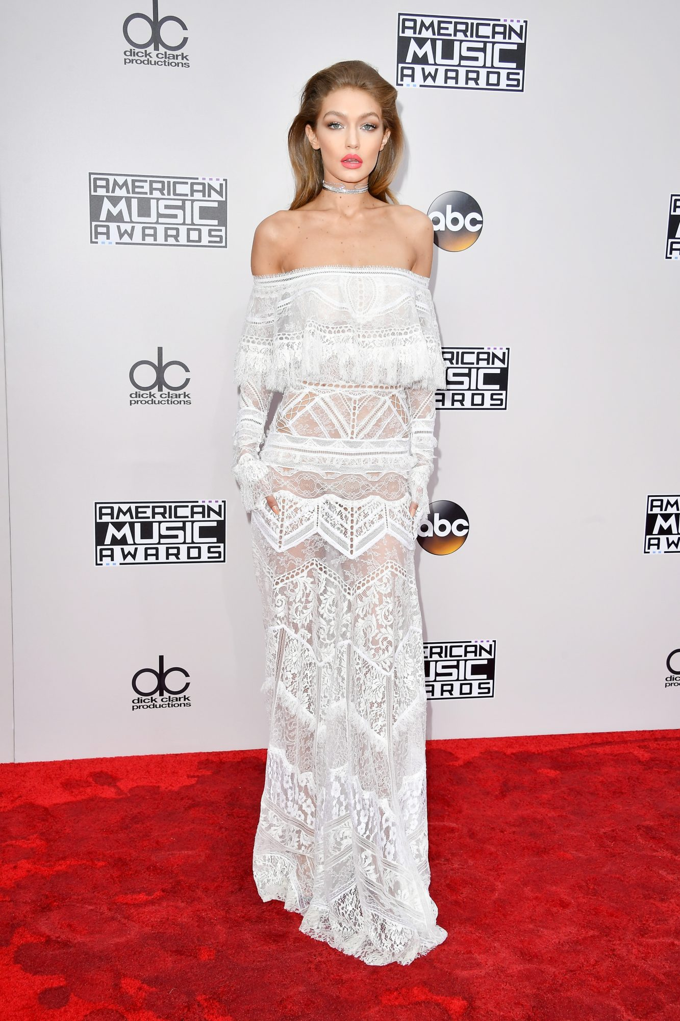 Gigi Hadid wearing a white Roberto Cavalli dress on the 2016 AMA red carpet
