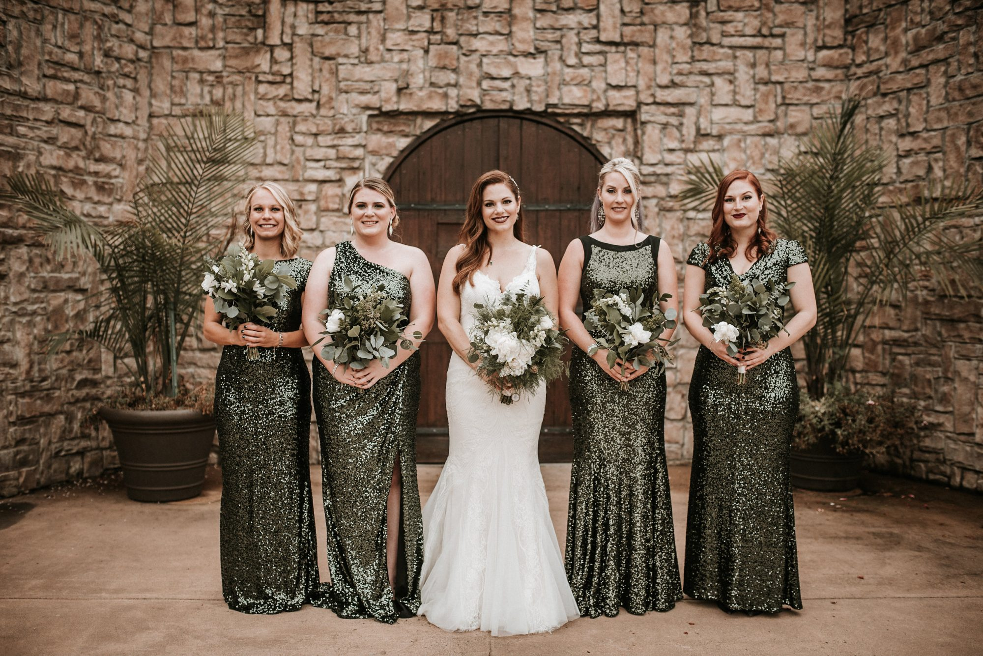 chic bridesmaids different sparkled gowns with bride