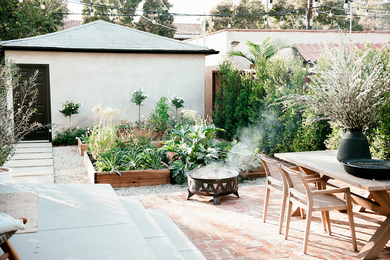 california backyard firepit and table