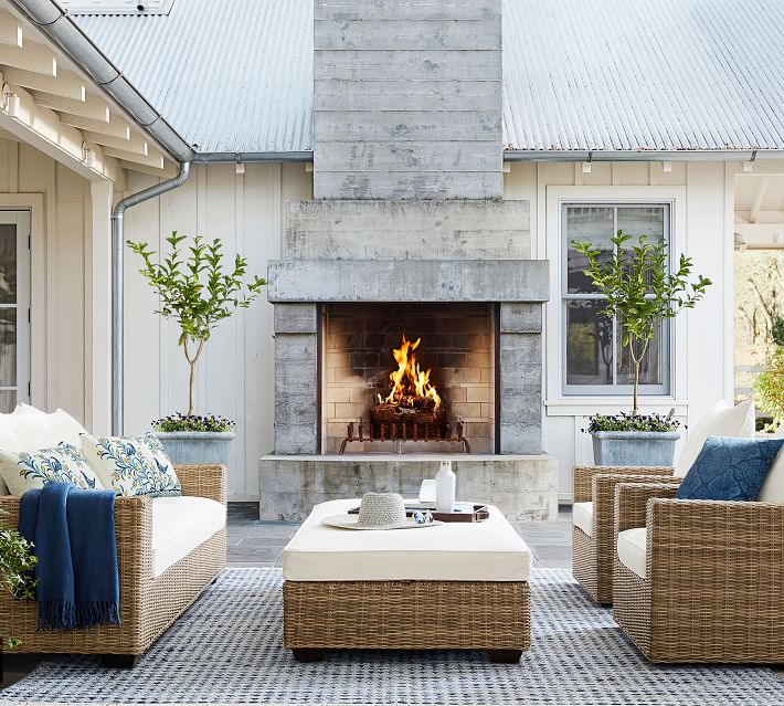 outdoor patio space with fireplace and rug