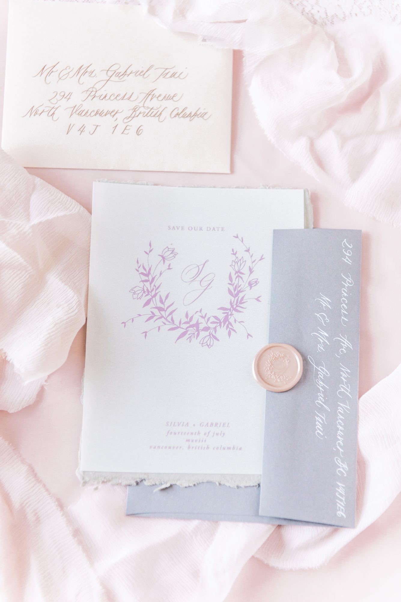 white save the date with lilac writing and envelope