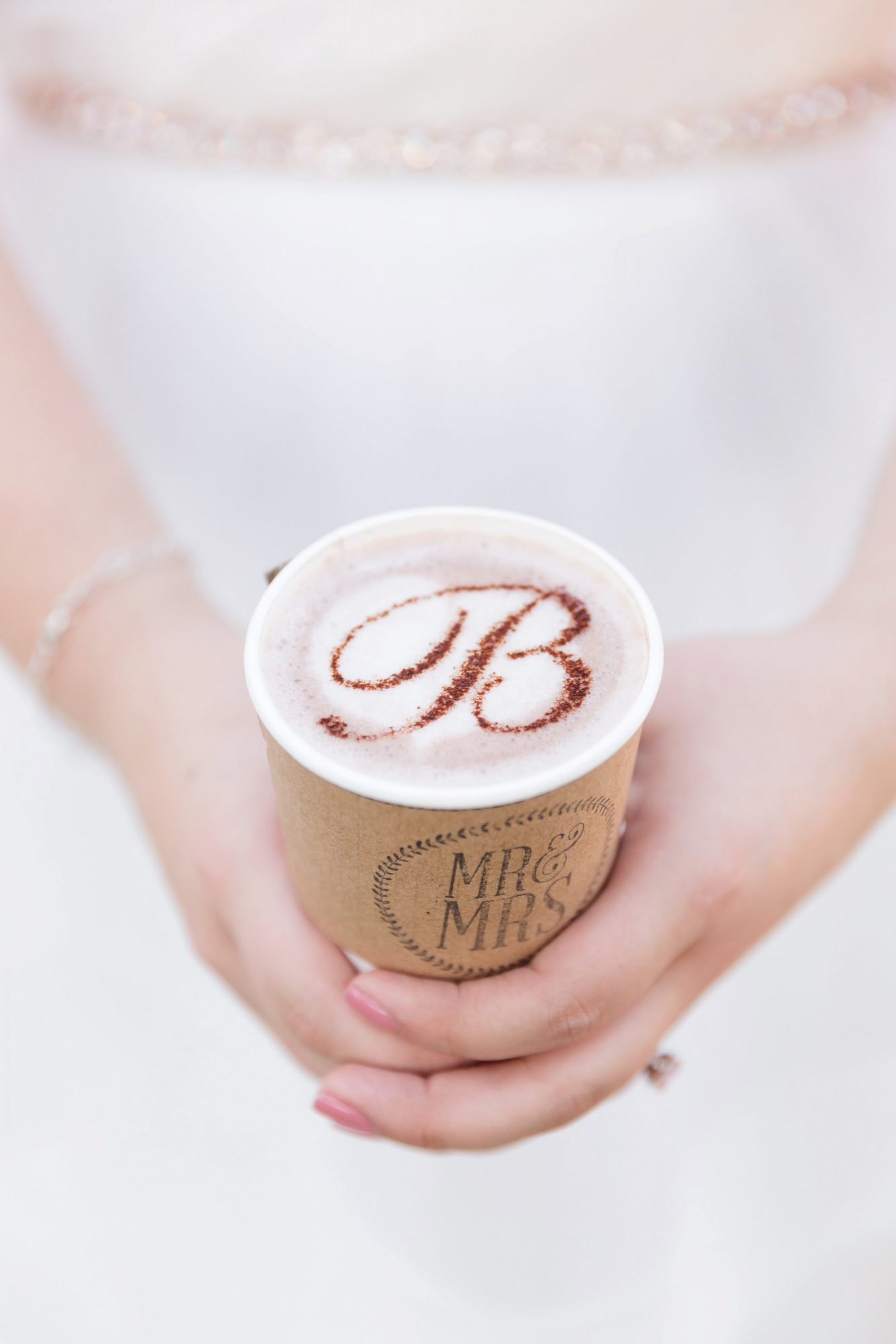 coffee wedding ideas woman holding monogrammed foam